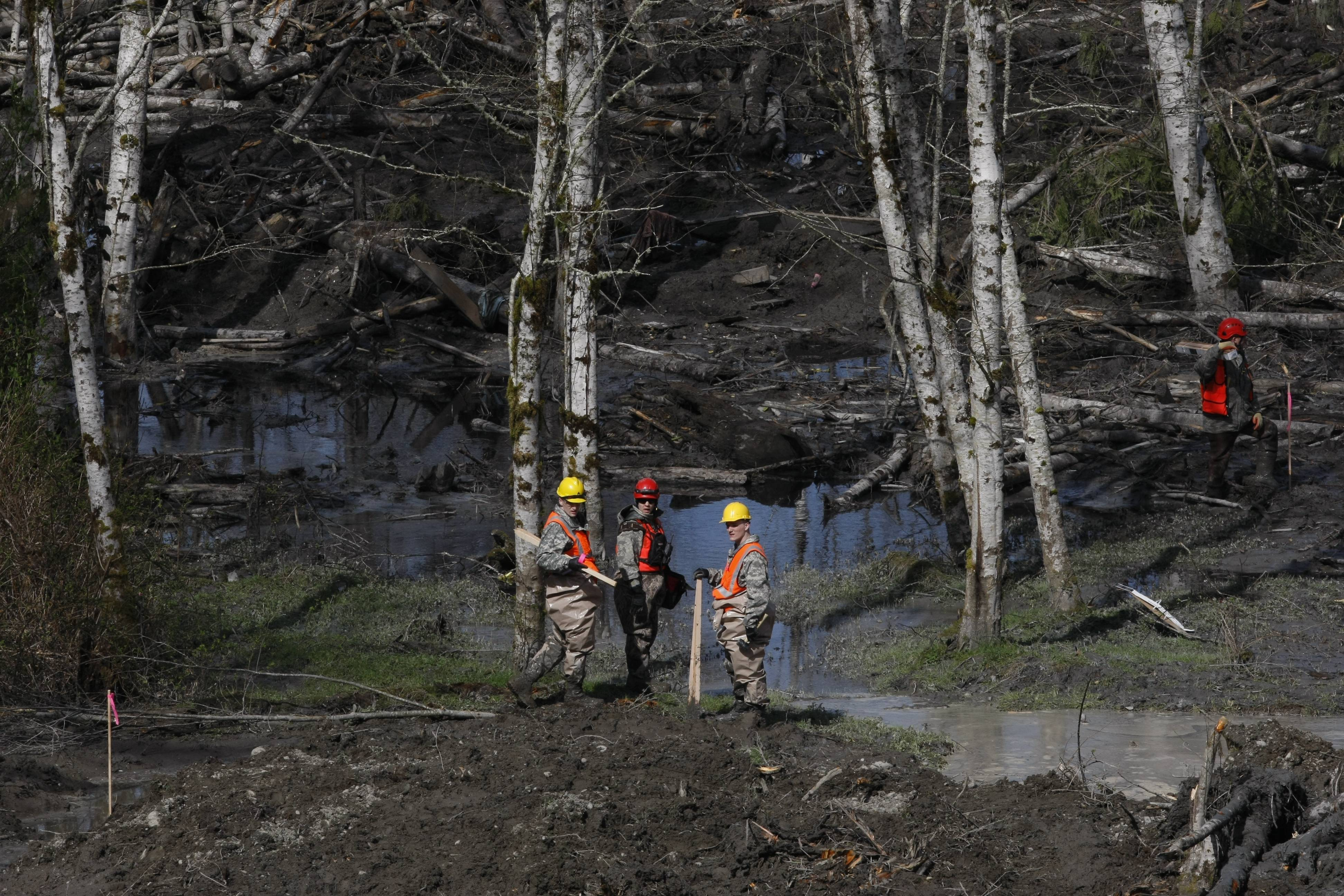Workers search for articles and belongings at the scene of the deadly March 22 mudslide, Monday in Oso, Wash.