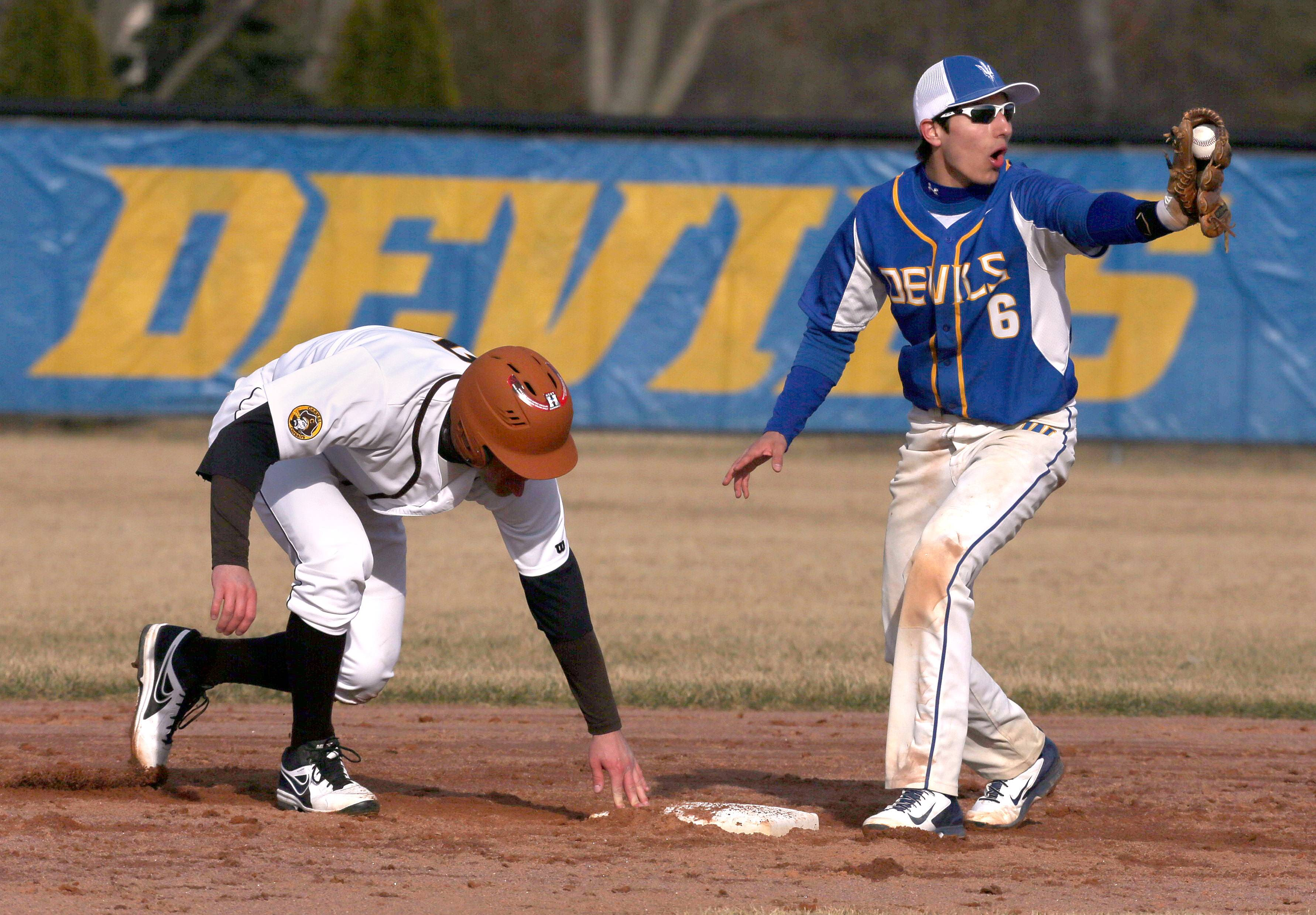Warren's Dominic Cuevas, right, is stunned by the call as Carmel's Quinten Sefcik is safe at second on Tuesday at Warren.