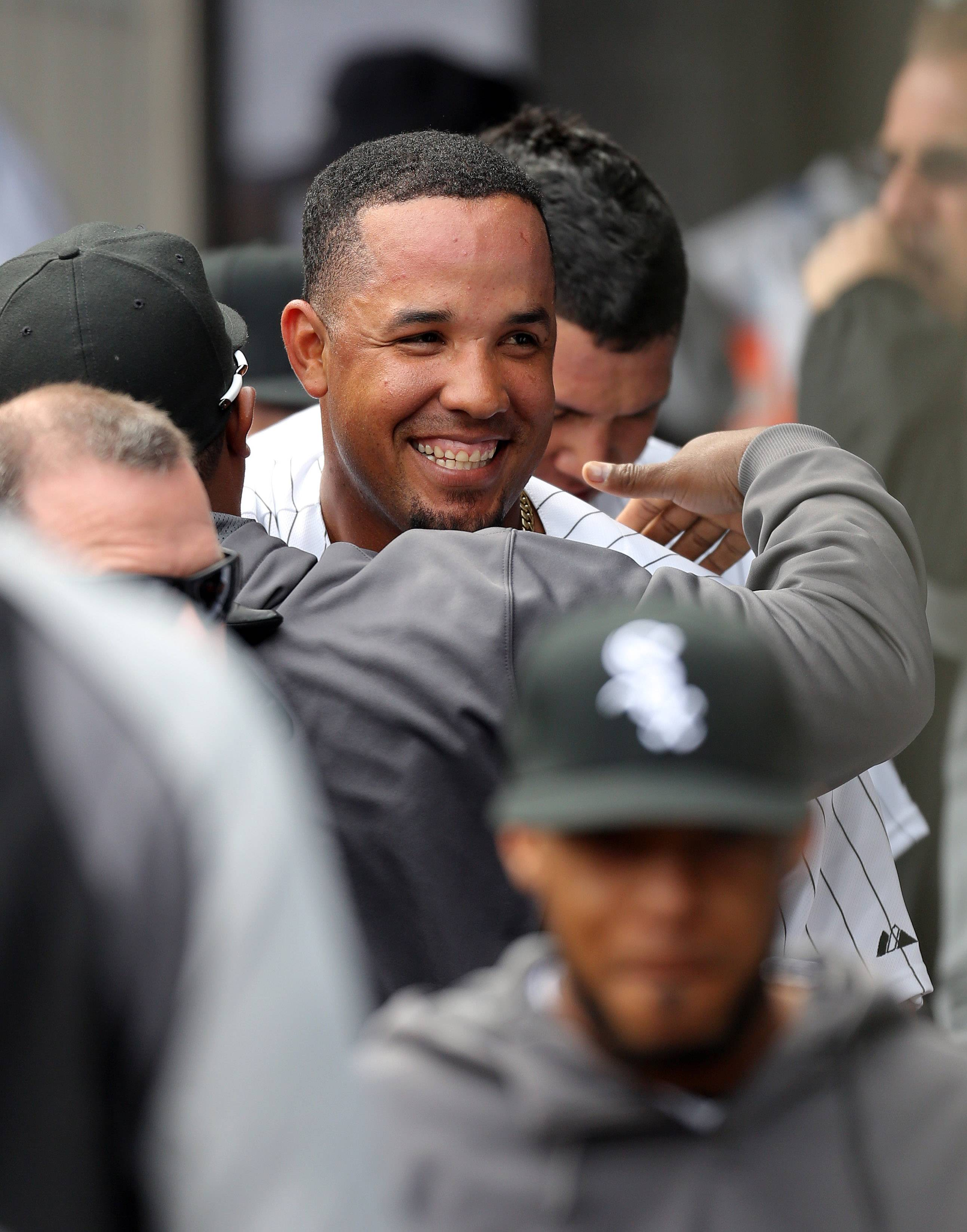 Chicago White Sox Jose Abreu celebrates in the dugout after scoring in the second inning during the White Sox home opener against the Minnesota twins Monday at US Cellular Field.