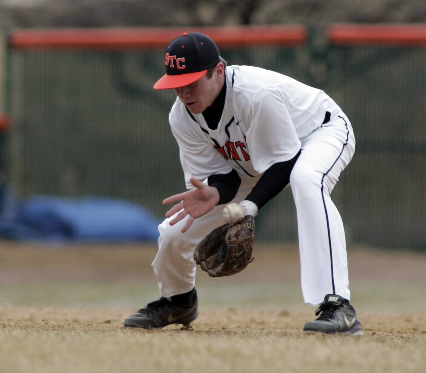 Saints' Jake Milosch, 18, reaches for a ground ball during West Aurora at St. Charles East baseball Tuesday.