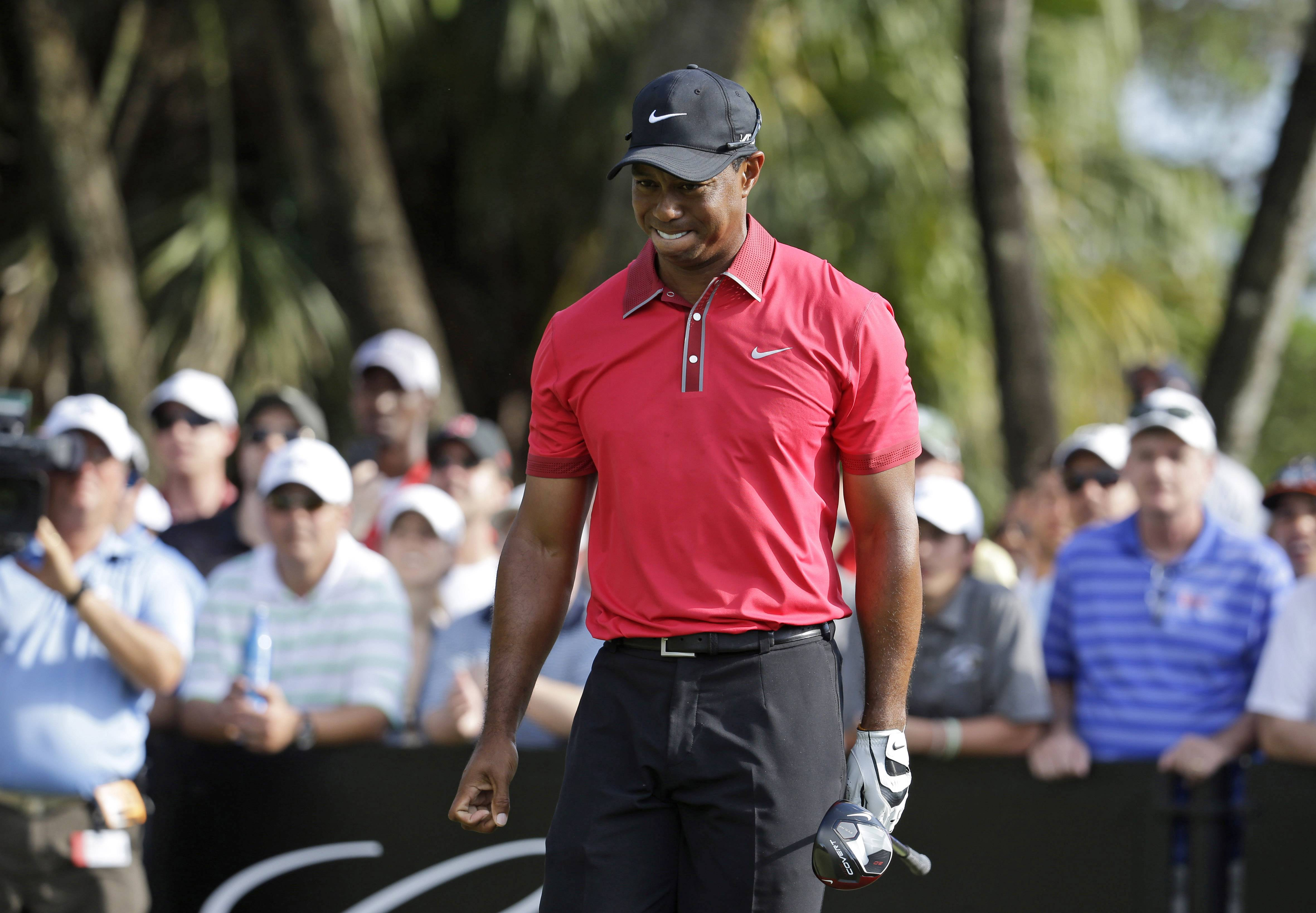 Associated PressIn this March 9, 2014 file photo, Tiger Woods grimaces after teeing off on the 12th hole during the final round of the Cadillac Championship golf tournament in Doral, Fla. Woods will miss the Masters for the first time in his career after having surgery on his back.