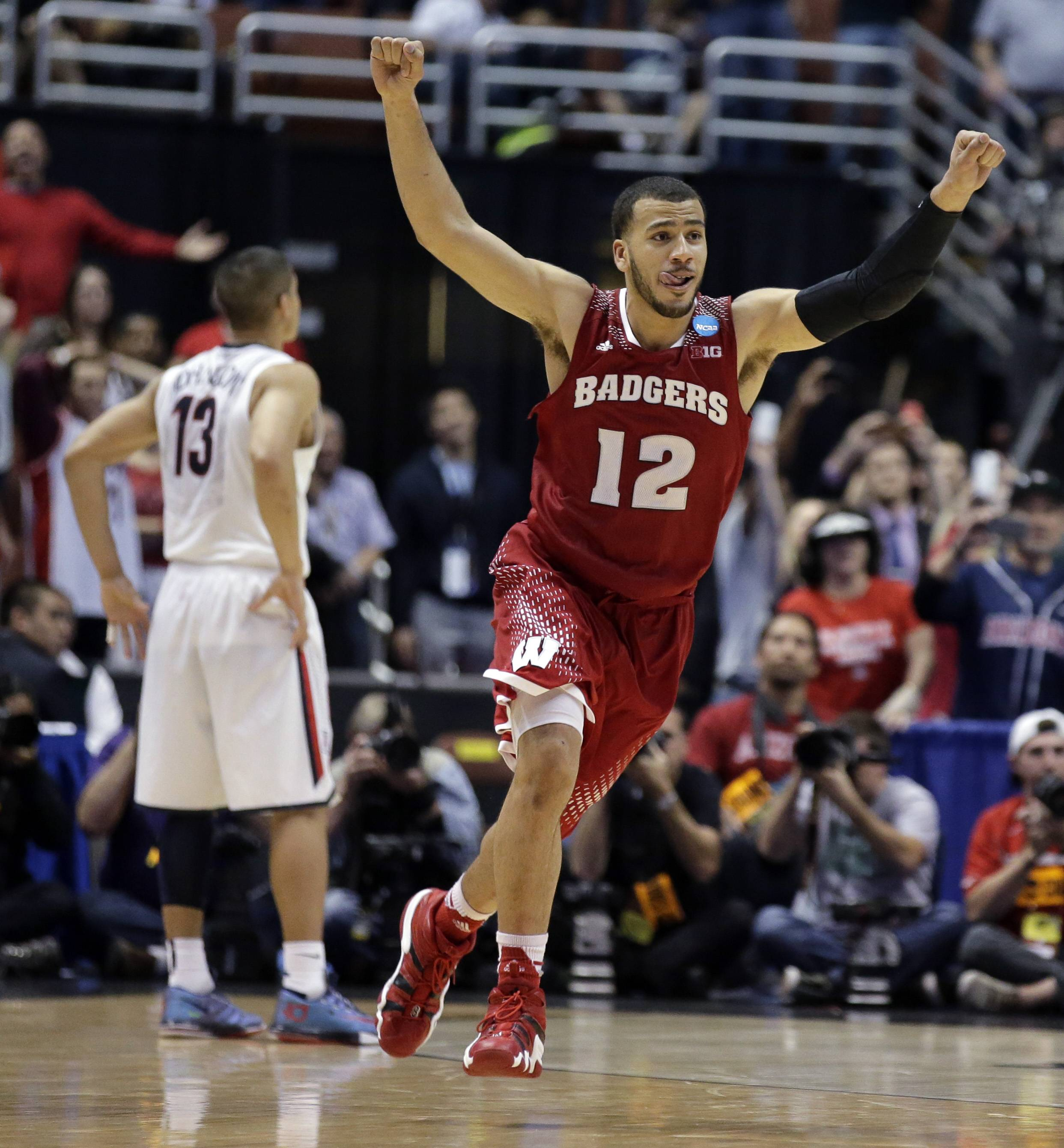 Wisconsin 's Traevon Jackson celebrates in front of Arizona's Nick Johnson (13) as time runs out in overtime of a regional final NCAA college basketball tournament game, Saturday in Anaheim, Calif. Wisconsin is now prepping for its Final Four game.
