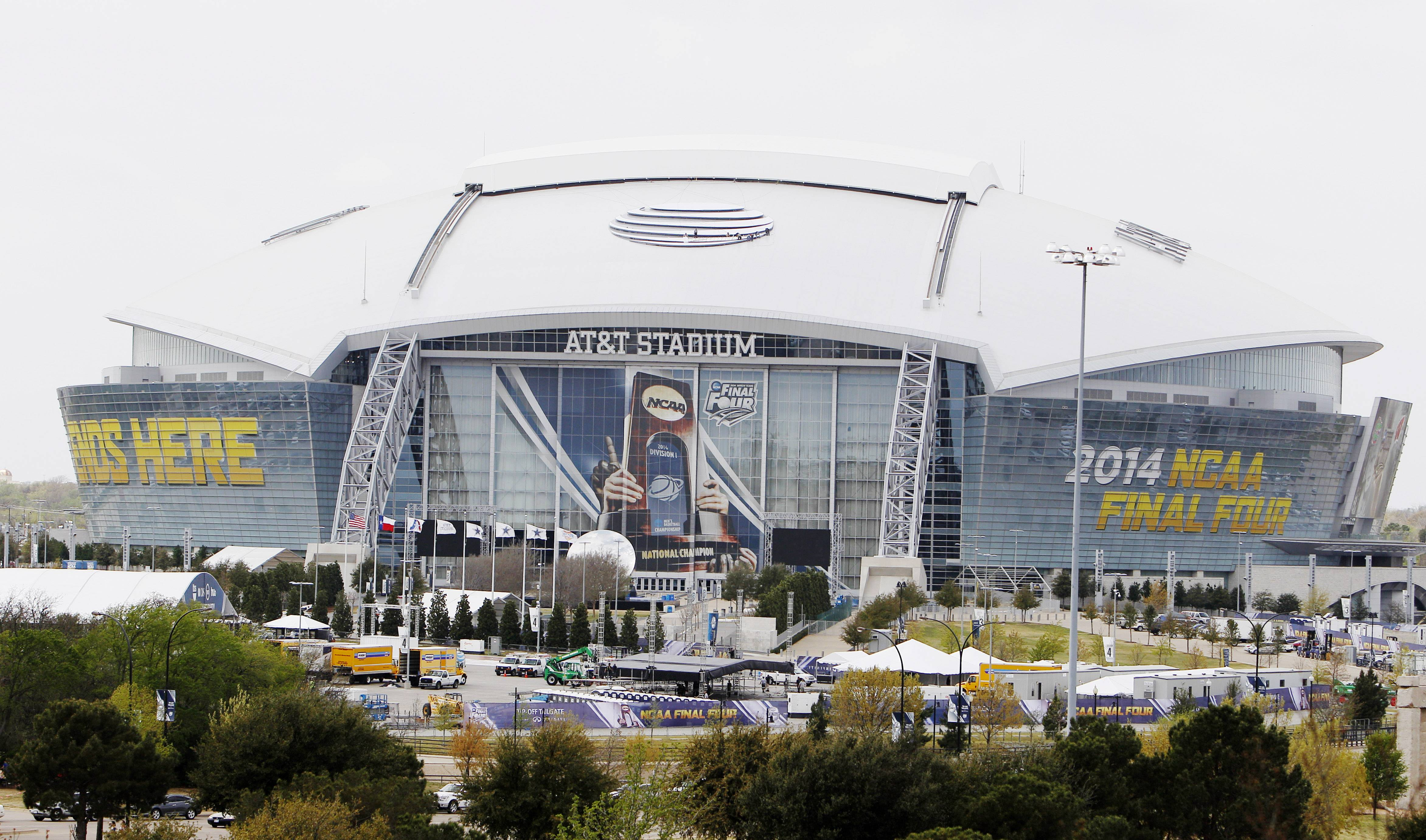 AT&T stadium, host of the 2014 NCAA Final Four, is seen from Globe Life Park Monday in Arlington, Texas. The final four teams have one thing in common: shutdown defenses.