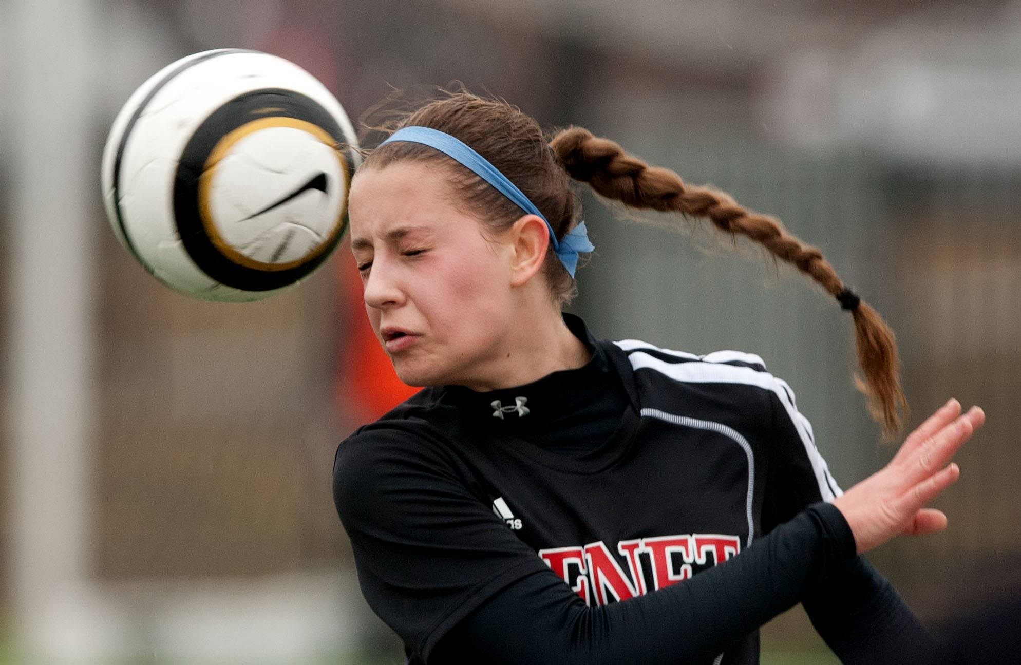 Benet's Loretta Elder heads the ball against Glenbard West during girls soccer action in Glen Ellyn.