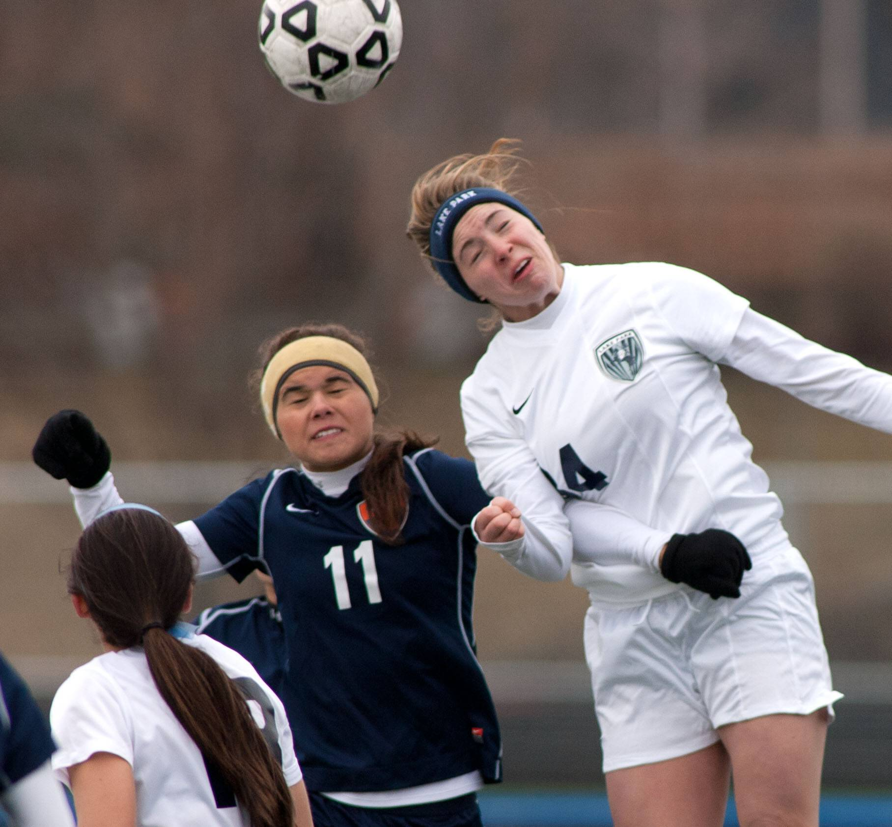 Buffalo Grove's Kim Herzog, left, challenges Lake Park's Lauren Bolnius during girls soccer action in Roselle.