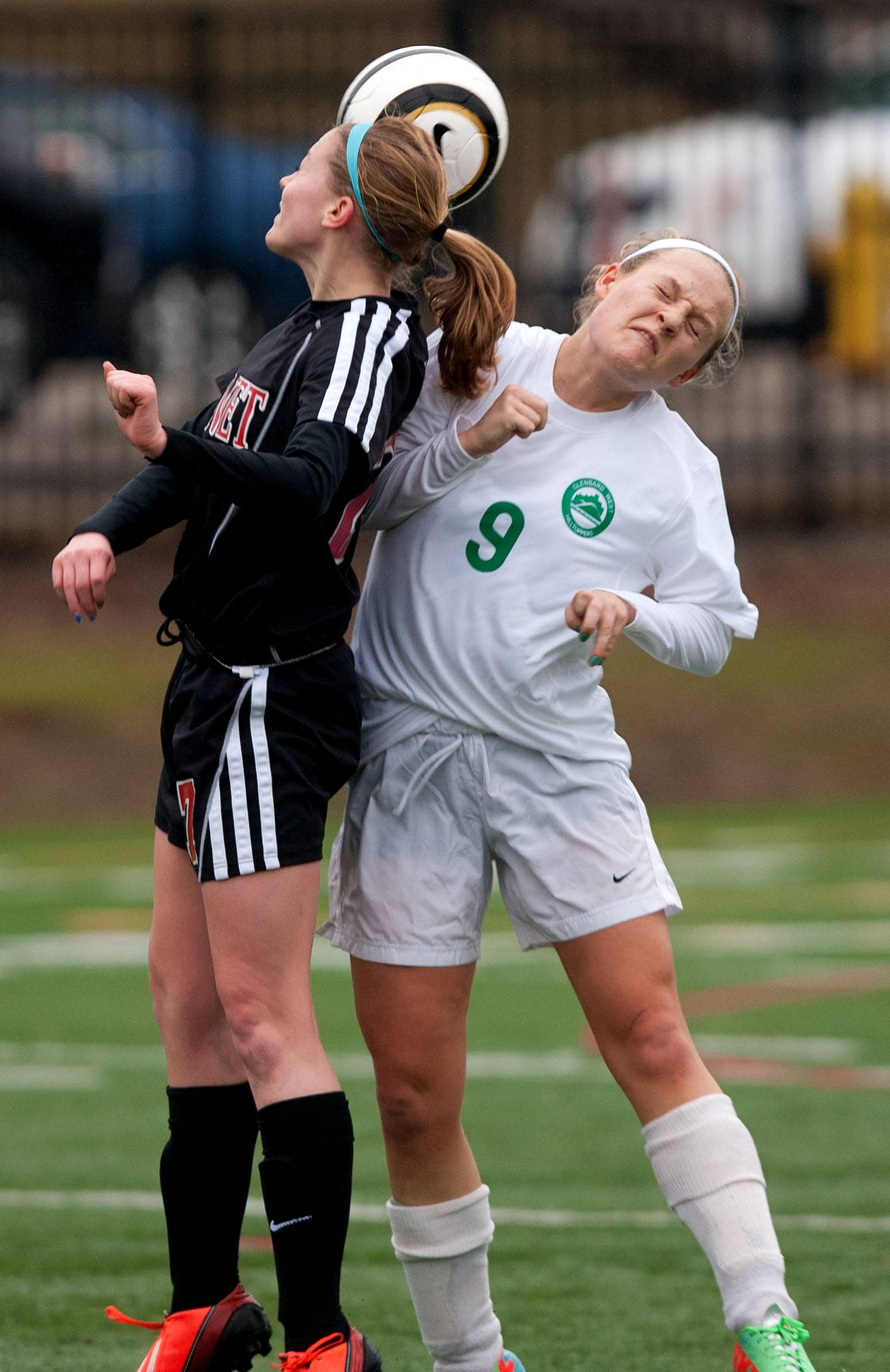 Benet's Jackie Kaufman, left, battles Glenbard West's Katie Strieker during girls soccer action.