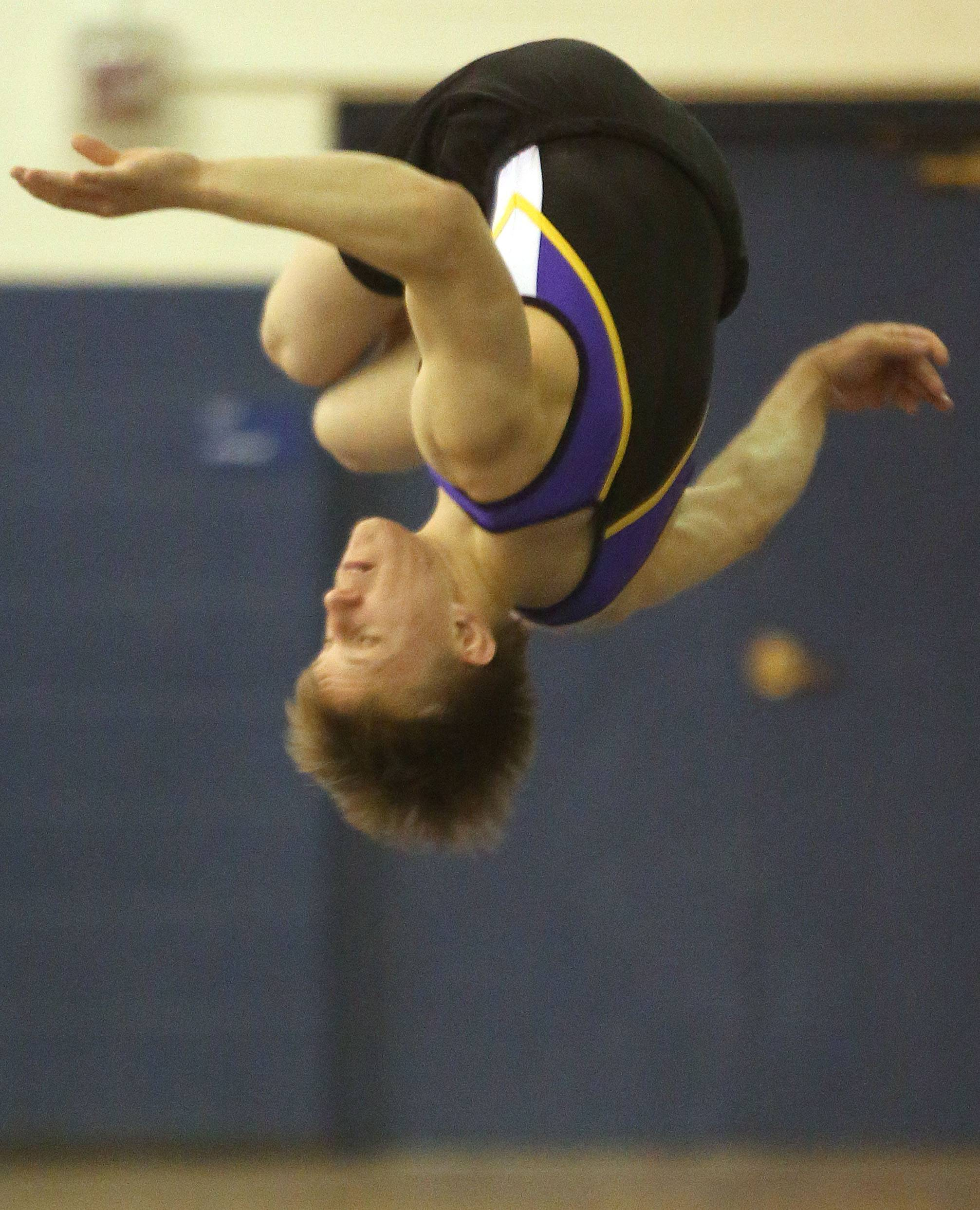 Rolling Meadow's Alex Smith performs his floor exercise routine during the Ralph Krupke Boys Gymnastics Invitational at Lake Park High School.
