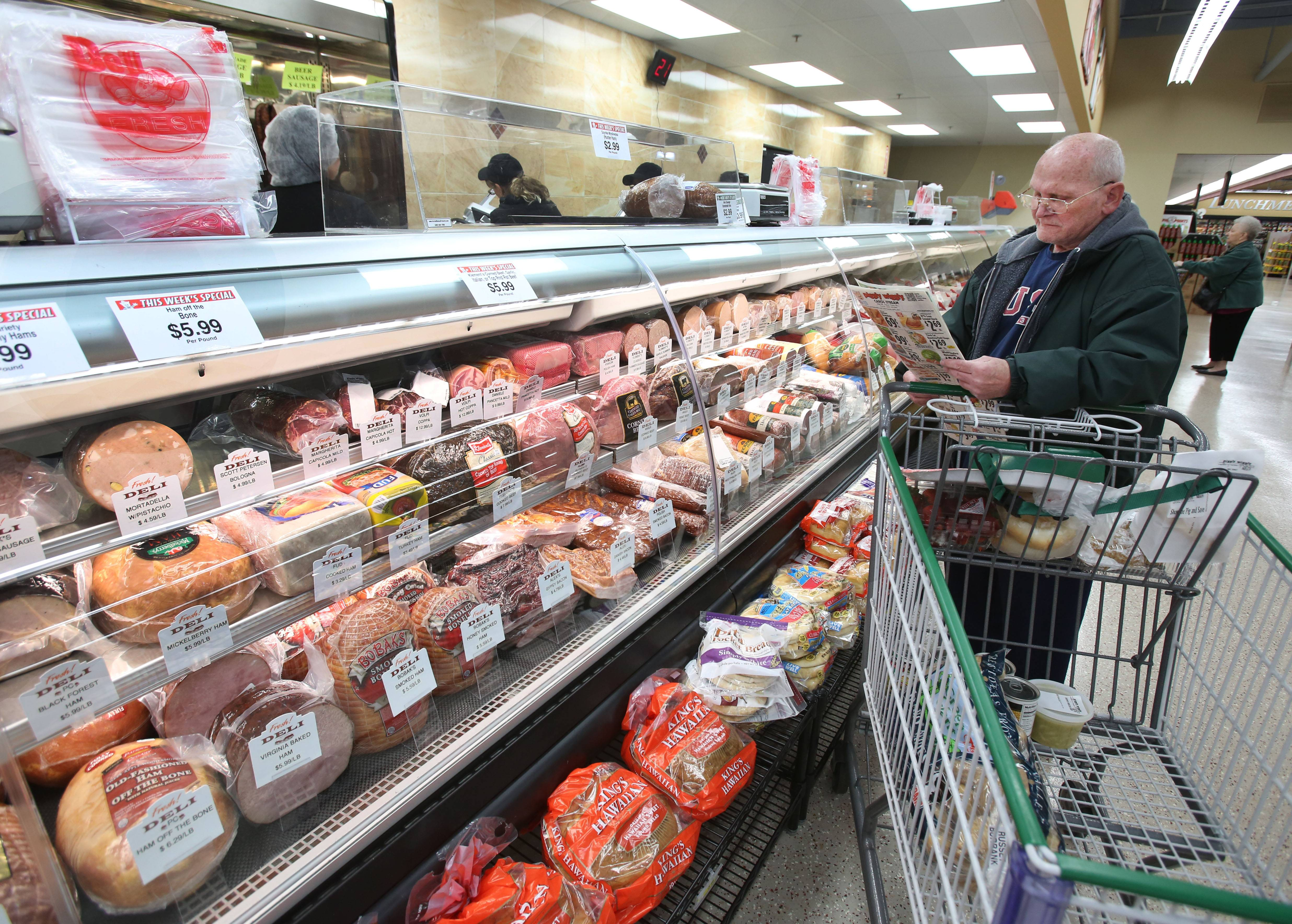 Richard Haiman of Hanover Park waits for an order at the deli in the new Piggly Wiggly grocery store in Carol Stream.