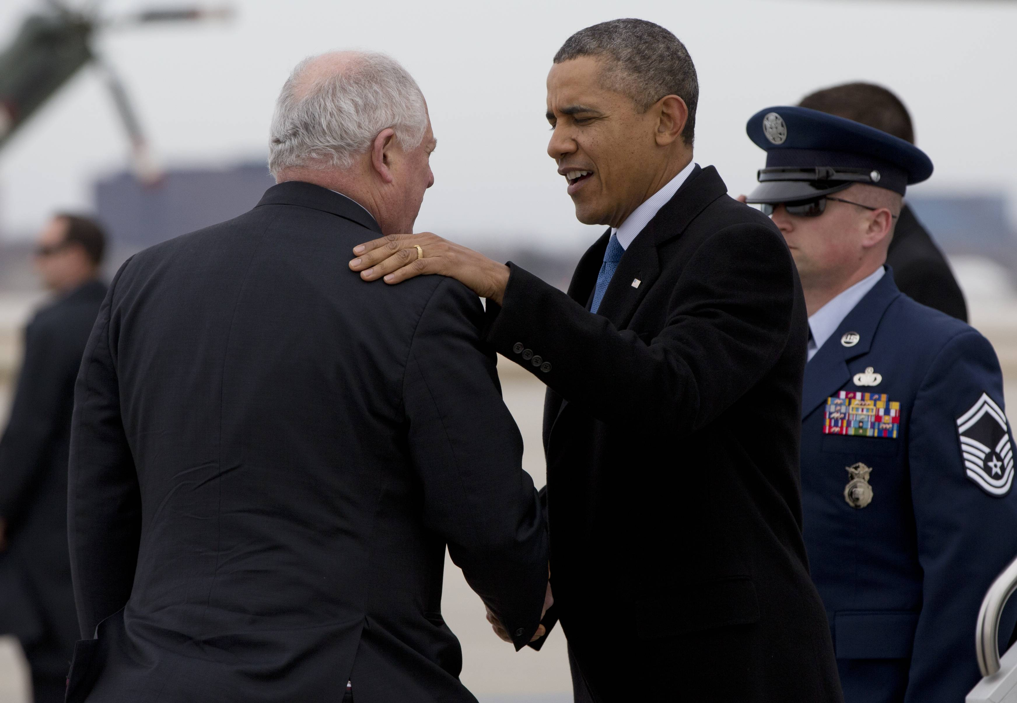 President Barack Obama is greeted by Illinois Gov. Pat Quinn as he arrives at Chicago O'Hare International Airport on Air Force One Wednesday, on his way to attend Democratic National Committee events in Chicago.
