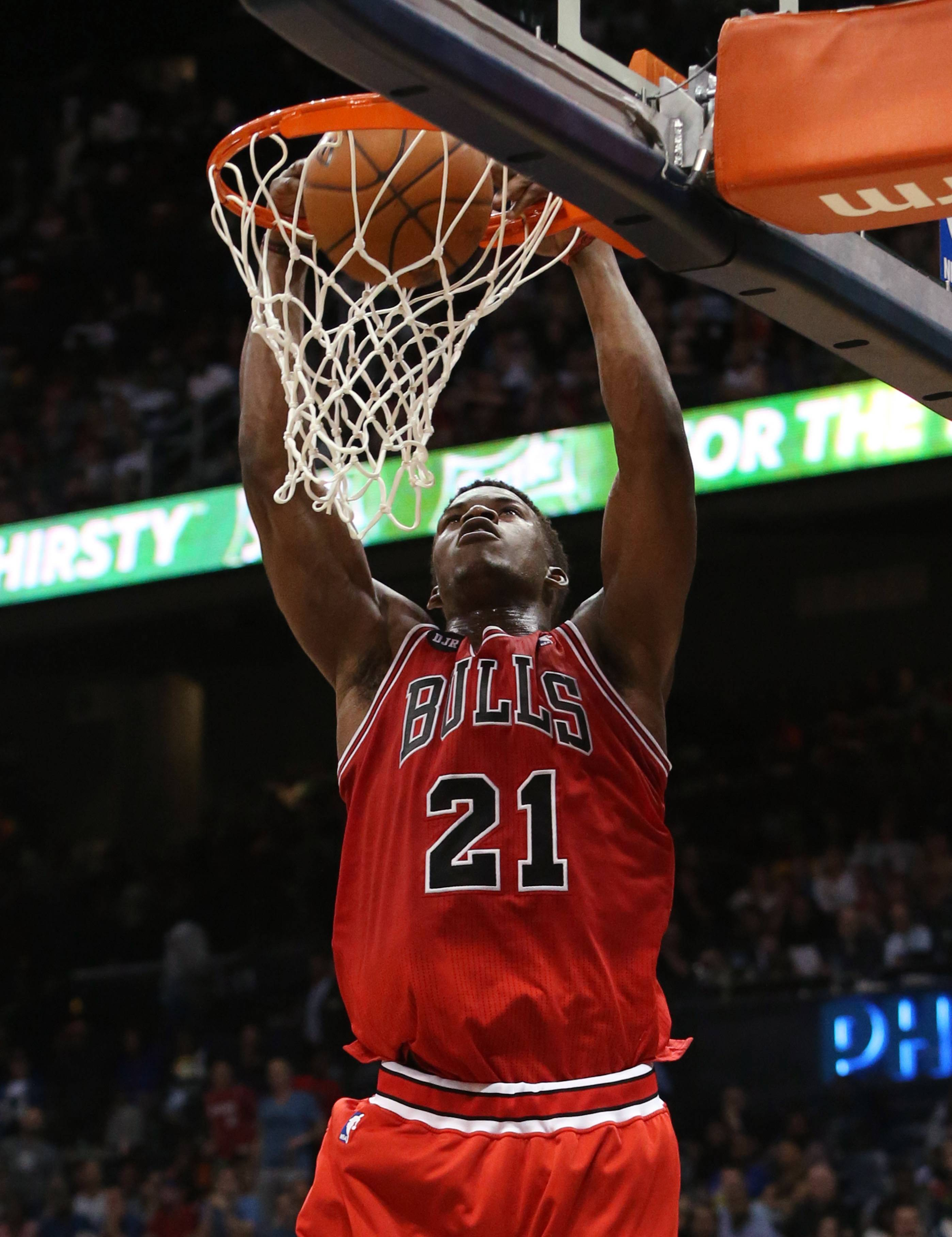 Bulls guard Jimmy Butler (21) goes up for a dunk in the second half of an NBA basketball game against the Atlanta Hawks on Wednesday in Atlanta. The Bulls won 105-92.