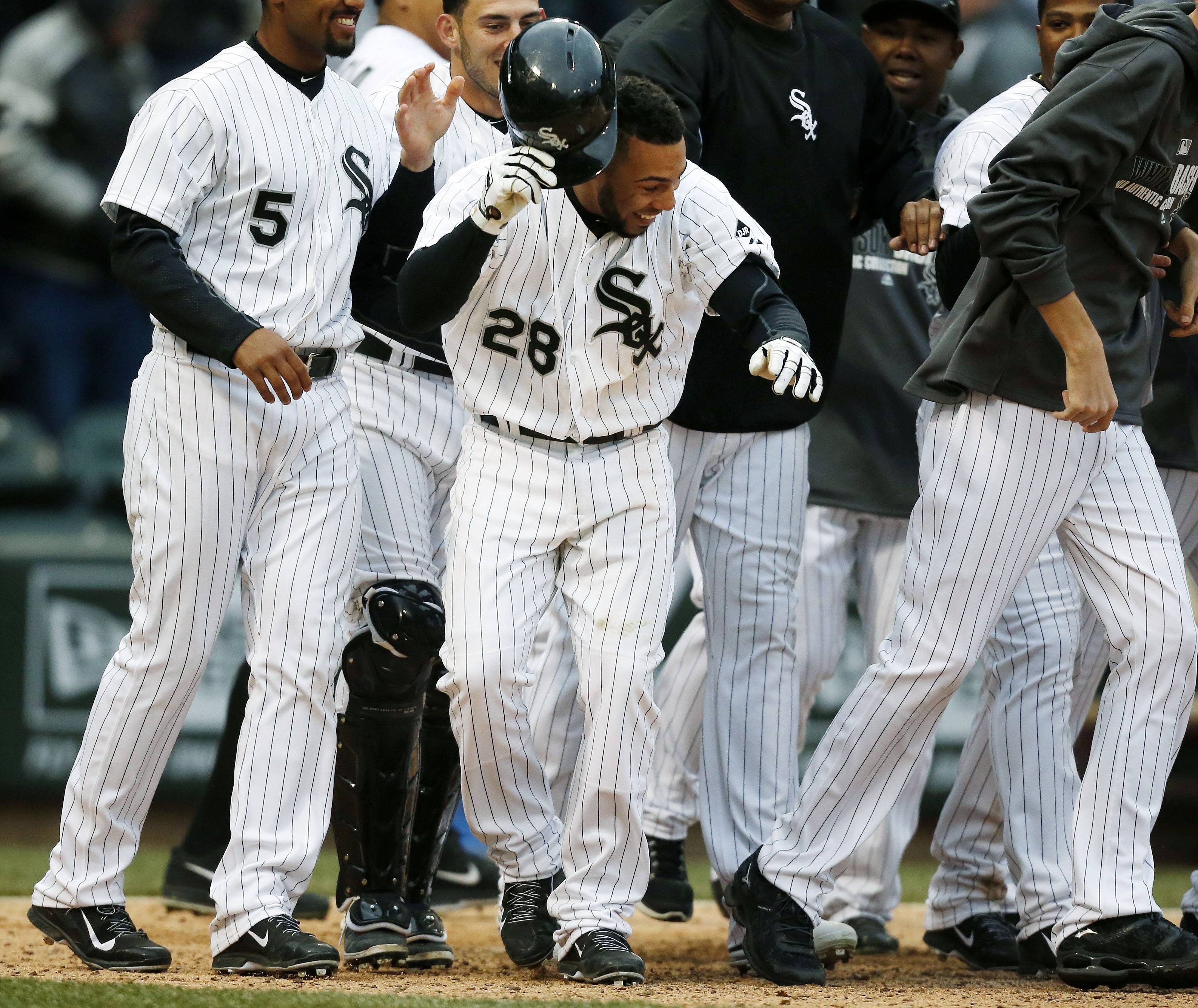 Leury Garcia celebrates with his White Sox teammates after scoring the winning run Wednesday on a wild pitch.