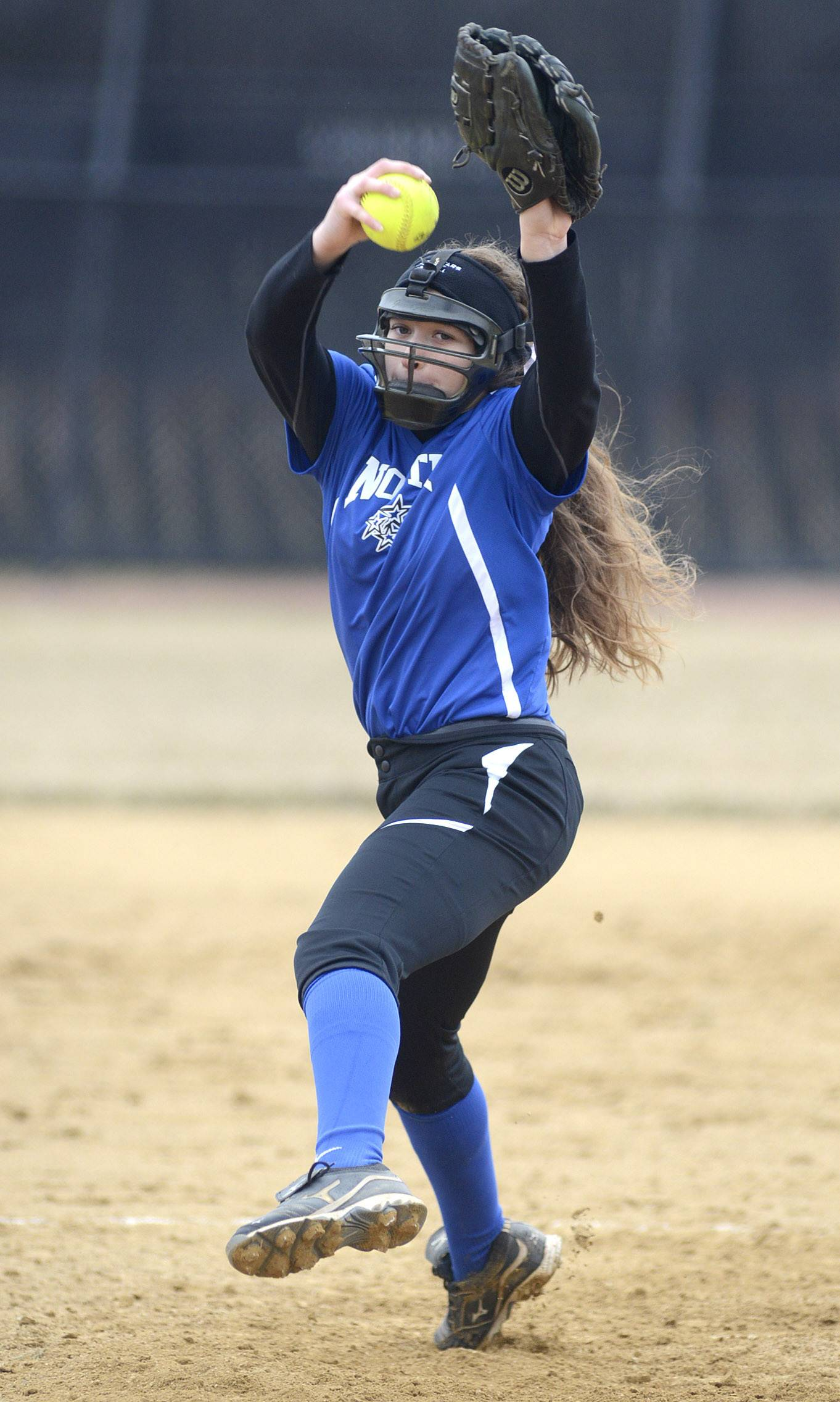Laura Stoecker/lstoecker@dailyherald.com St. Charles North's Sabrina Rabin pitches in the game vs. Schaumburg on Wednesday, April 2.