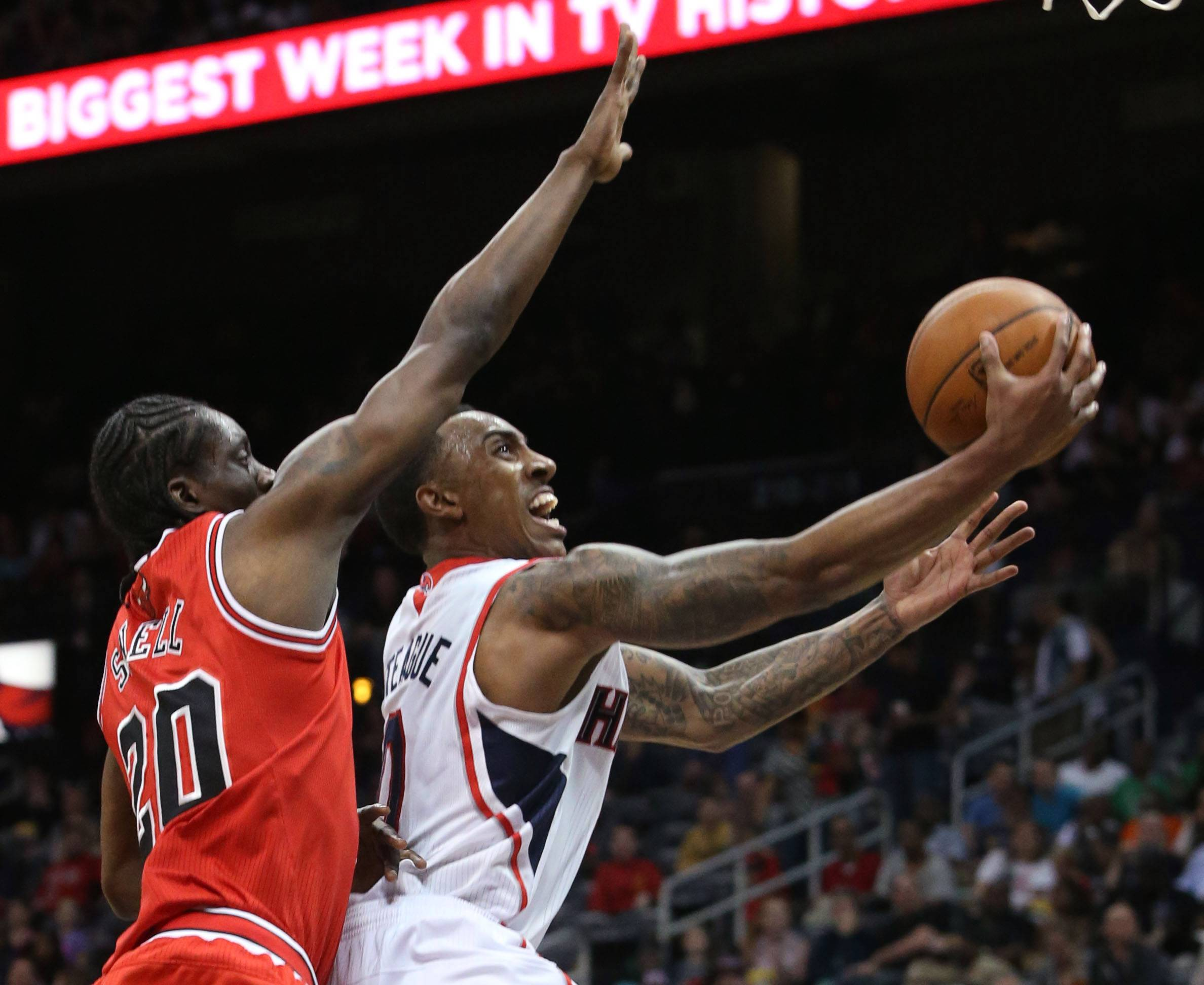 Atlanta Hawks guard Jeff Teague (0) shoots in front of Chicago Bulls guard Tony Snell (20) during the first half of an NBA basketball game Wednesday in Atlanta.