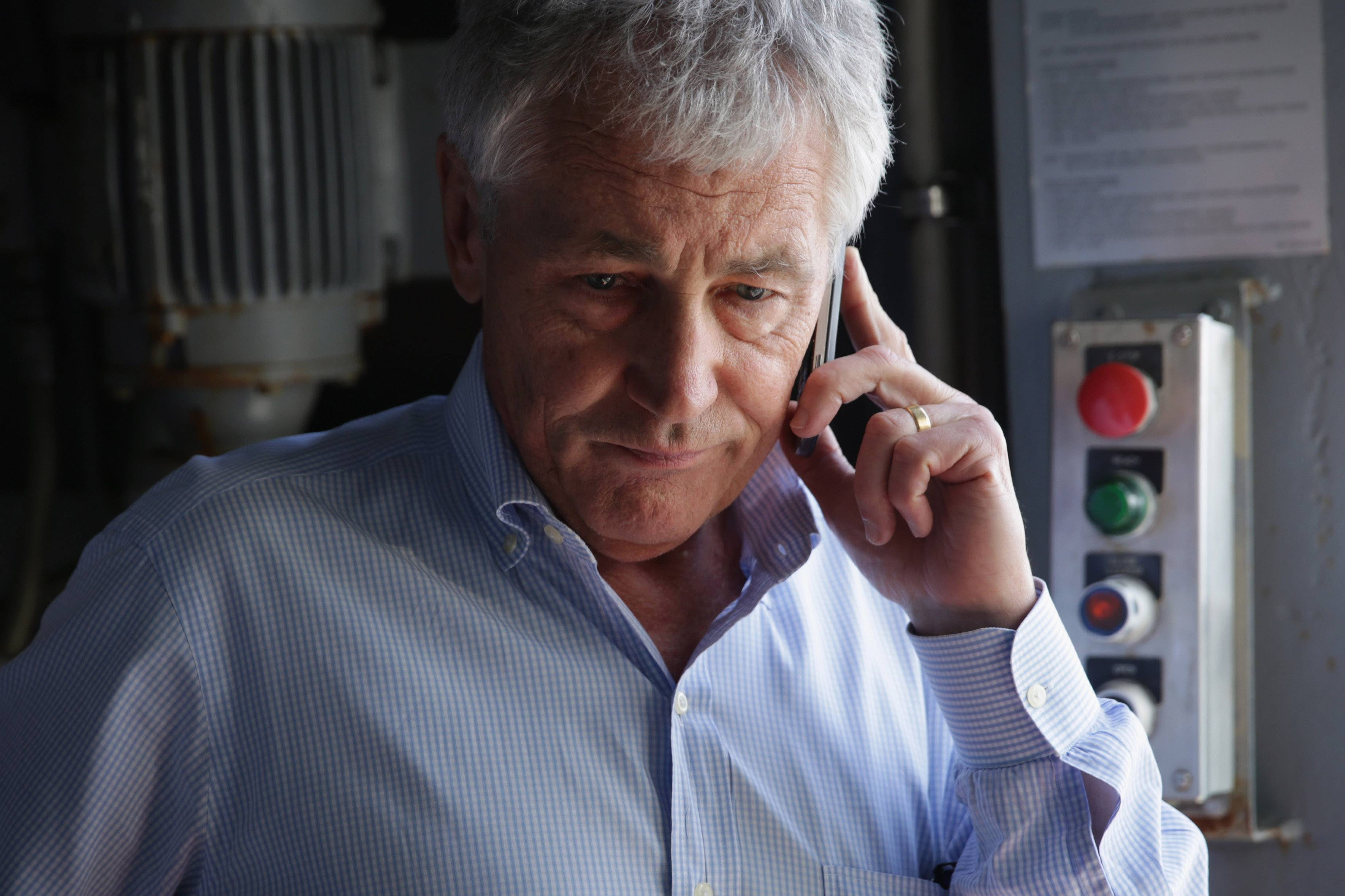 U.S. Secretary of Defense Chuck Hagel receives an update on the phone on the shooting at Fort Hood in Texas, as he was on a tour of the USS Anchorage, an amphibious transport dock ship, with his counterparts from Southeast Asia on Wednesday at Joint Base Pearl Harbor-Hickam in Honolulu, Hawaii.
