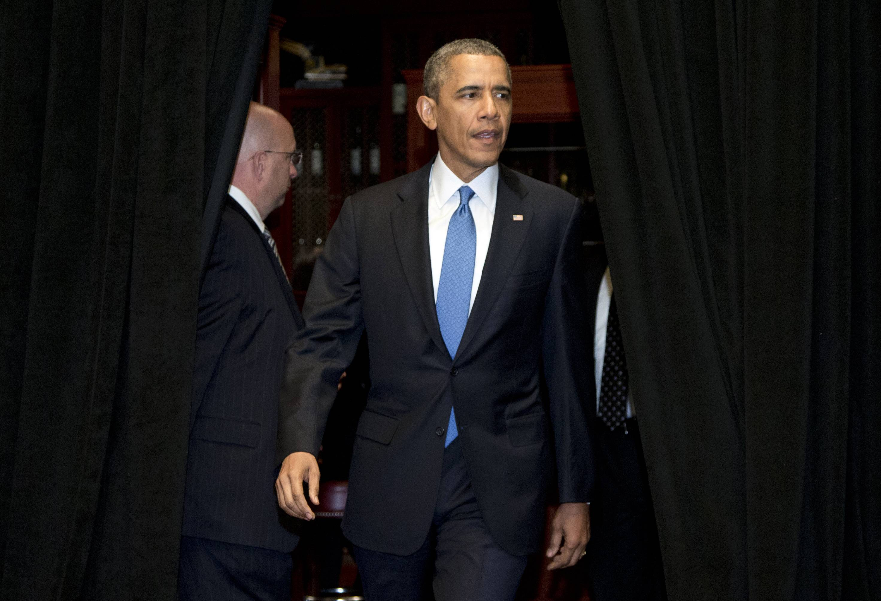 President Barack Obama arrives to speak Wednesday in Chicago about the shooting at Fort Hood.