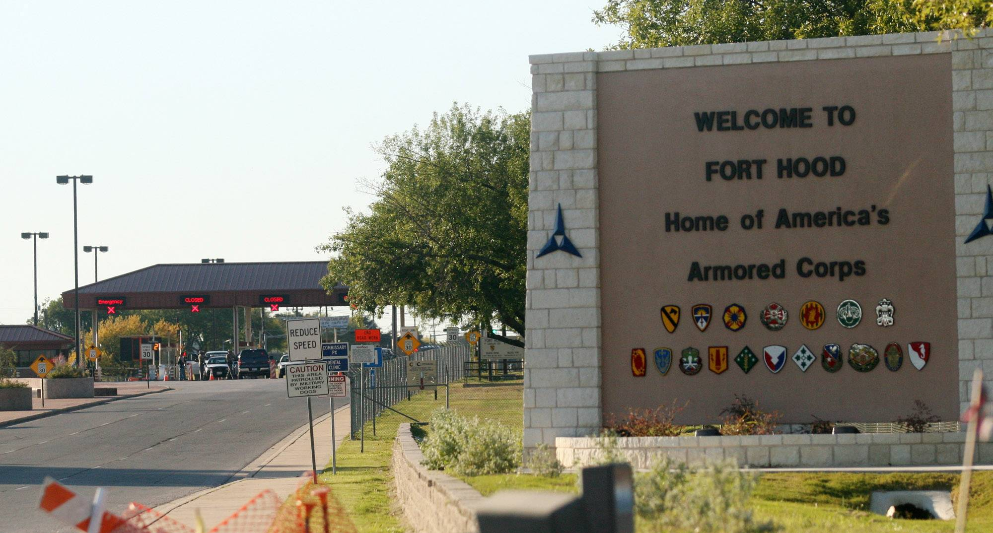 In this Thursday, Nov. 5, 2009, file photo, an entrance is shown to Fort Hood Army Base in Fort Hood, Texas. Fort Hood says there's been a shooting Wednesday at the Texas Army base and that there have been injuries.