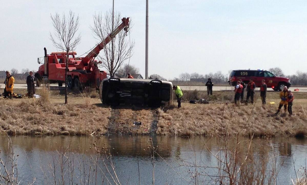Rescue crews were on the scene quickly after a car went into a pond Wednesday morning at Algonquin Commons.