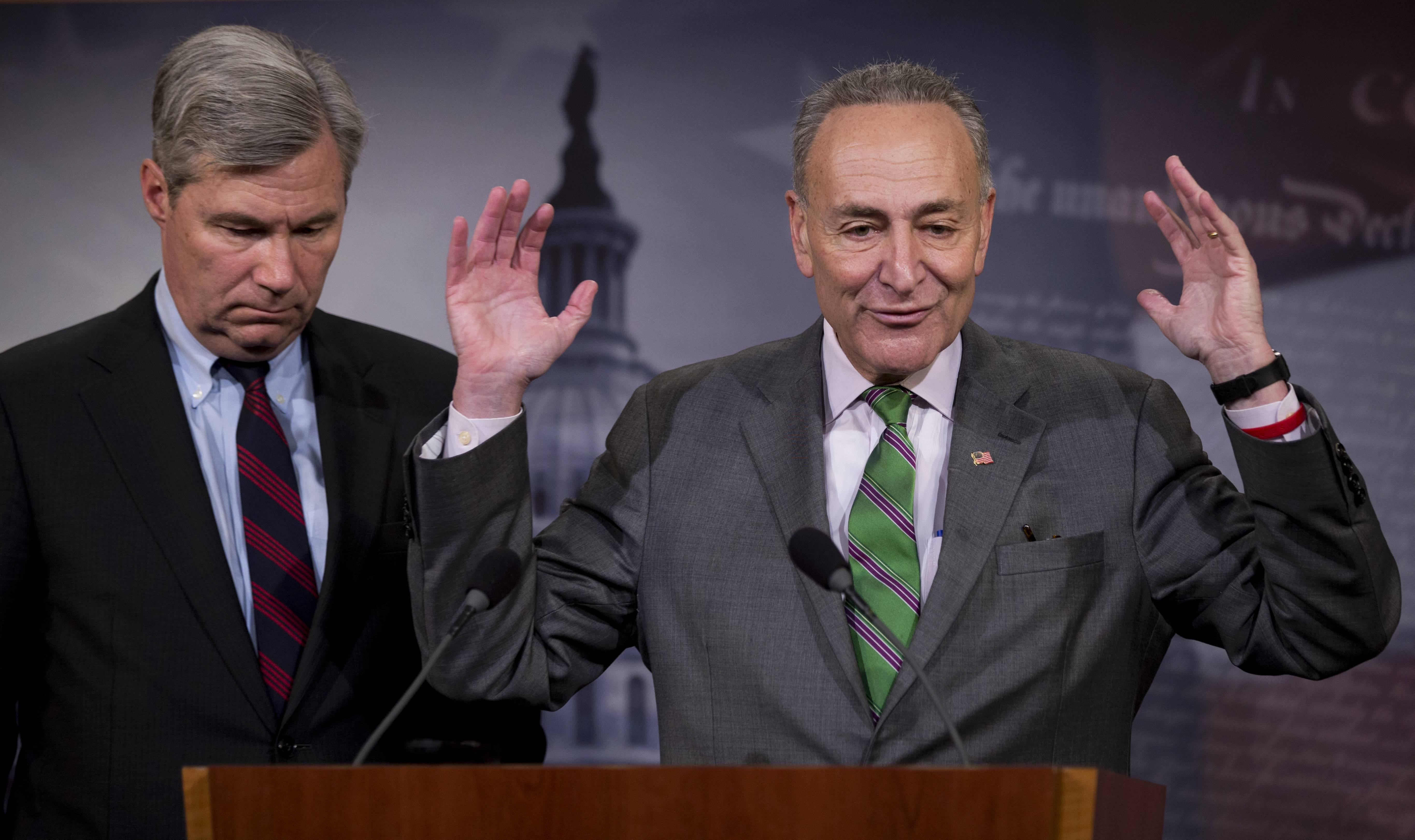 Democratic Sens. Charles Schumer of New York, right, and Sheldon Whitehouse of Rhode Island discuss the Supreme Court�s decision to strike down limits in federal law on the aggregate campaign contributions individual donors may make to candidates, political parties and political action committees, Wednesday on Capitol Hill.