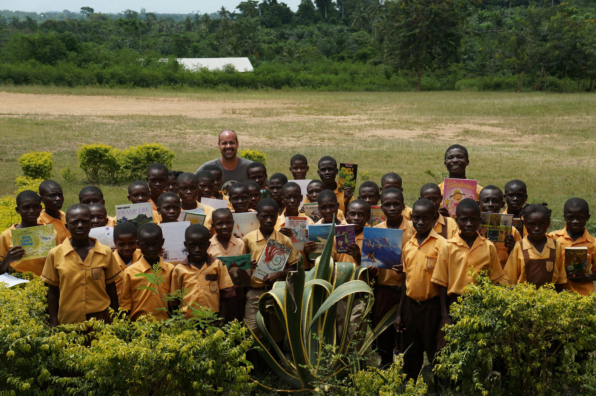 Jim Reed, a sixth-grade gifted teacher at Sycamore Trails Elementary School in Bartlett, carried hundreds of books with him to give to students at this school in Ghana.