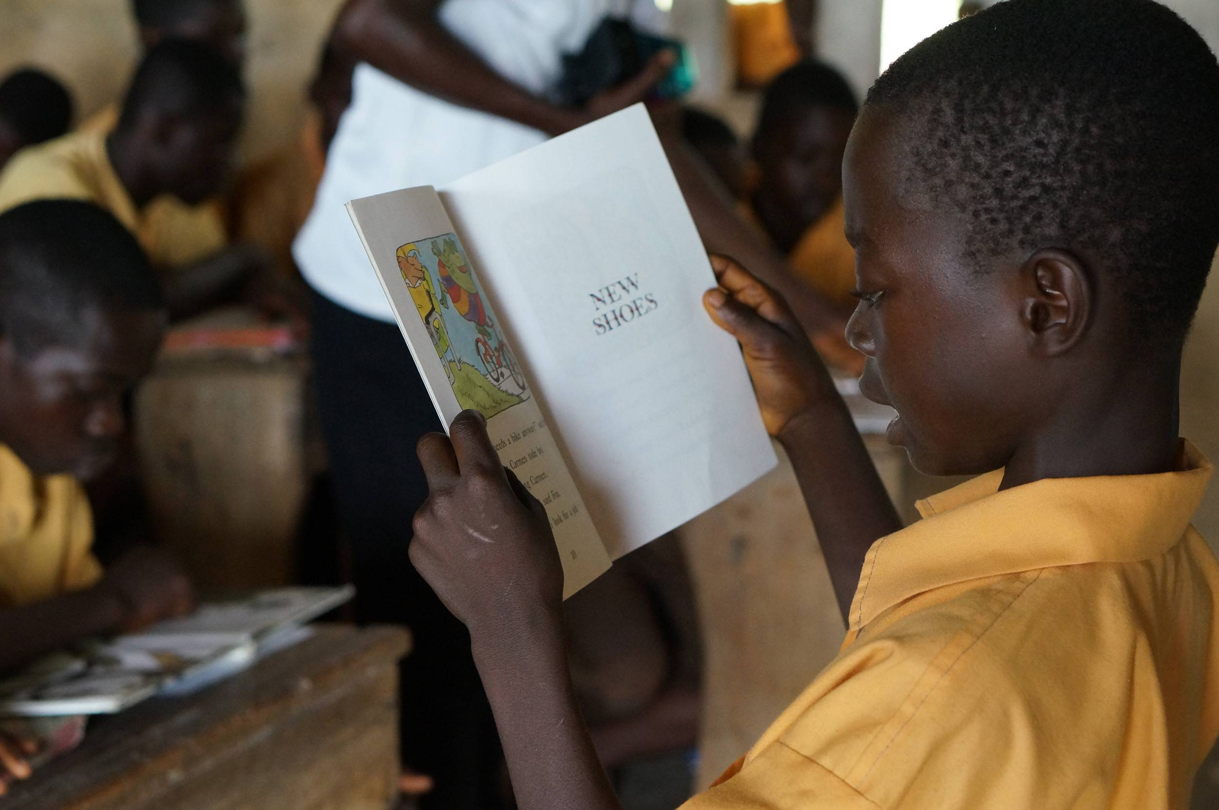 Lord Fotwe Mendts, a pen pal of Sycamore Trails Elementary School student Lindsey Brownfield, reads in front of his classroom in Ghana.