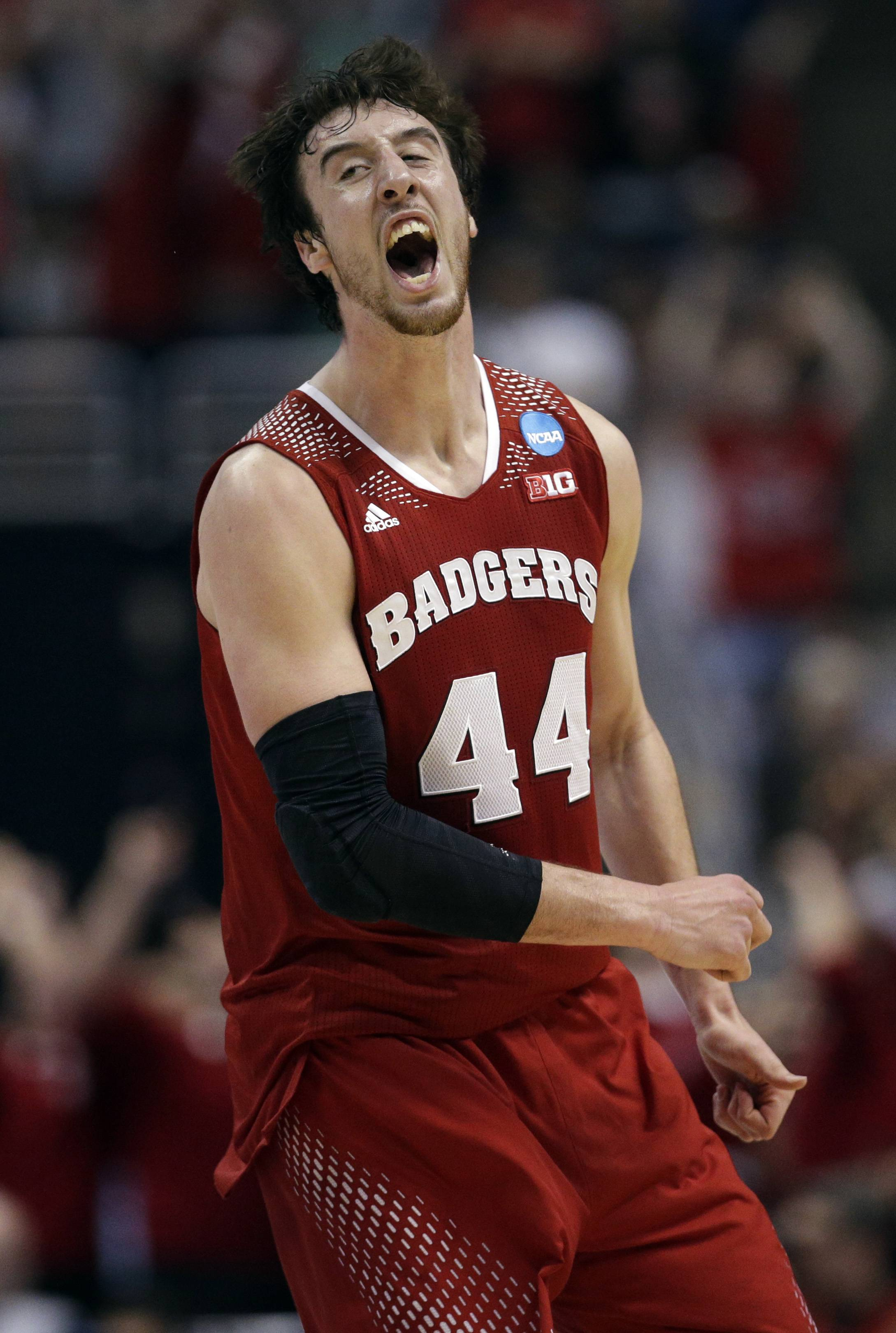 Wisconsin 's Frank Kaminsky reacts after making a three-point basket during the second half in a regional final NCAA college basketball tournament game against Arizona on March 29 in Anaheim, Calif.