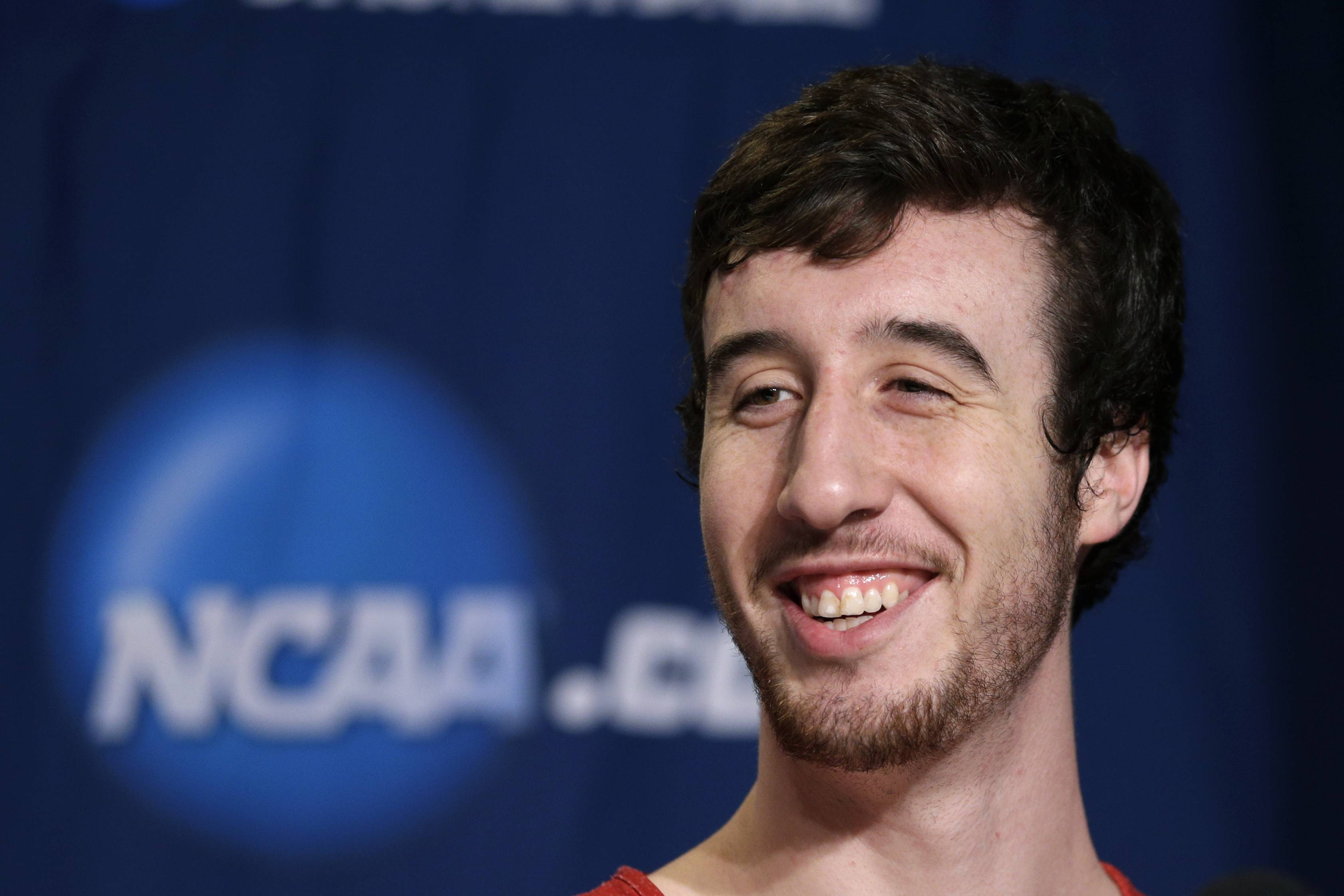 Wisconsin's Frank Kaminsky answers questions from members of the media during a news conference at the NCAA college basketball tournament on March 28 in Anaheim, Calif. Wisconsin plays Arizona in a regional final on Saturday.