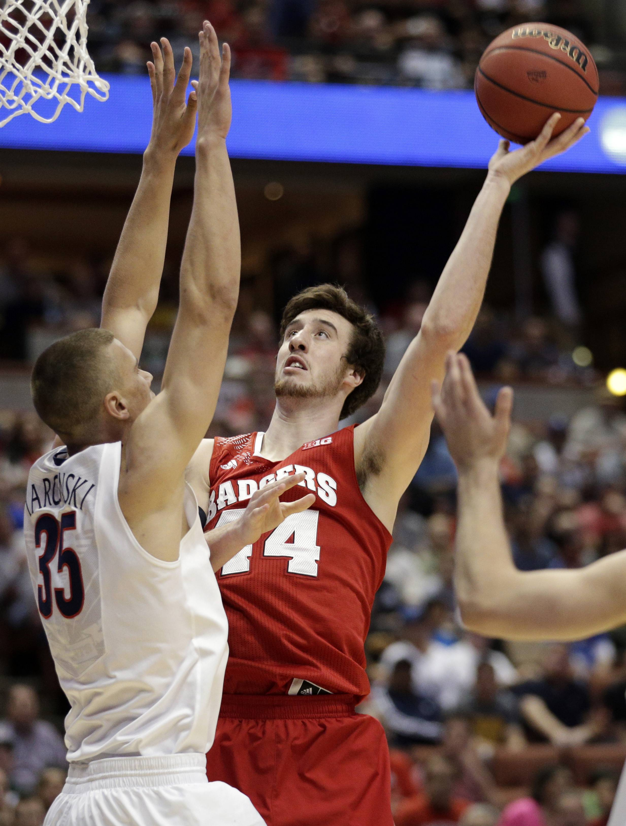Wisconsin forward Frank Kaminsky shoots past Arizona's Kaleb Tarczewski (35) during the first half in a regional final NCAA college basketball tournament game March 29 in Anaheim, Calif.