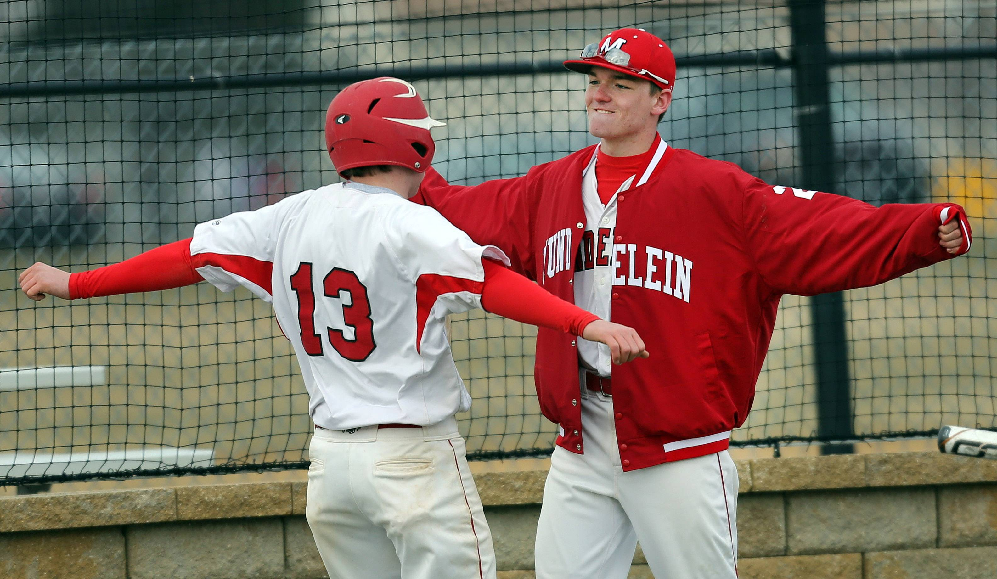 Mundelein's Luke Peterson, left and Luke Adams bump chests after Petersen scored against Wheeling on Wednesday at Mundelein.