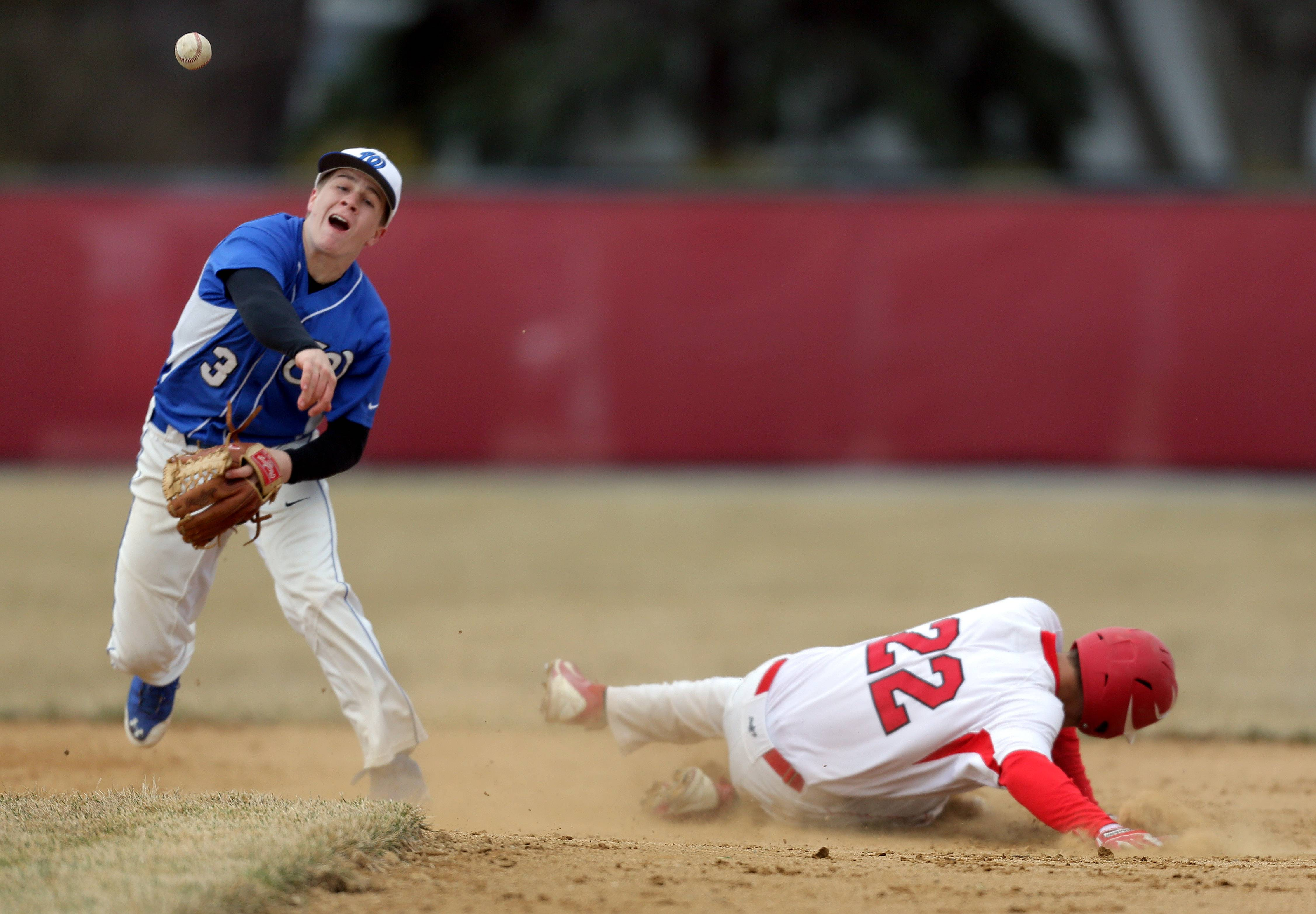 Wheeling's Matt Volmer, left, tries to turn a double play as Mundelein's Ryan Hollander is out at second on Wednesday at Mundelein.