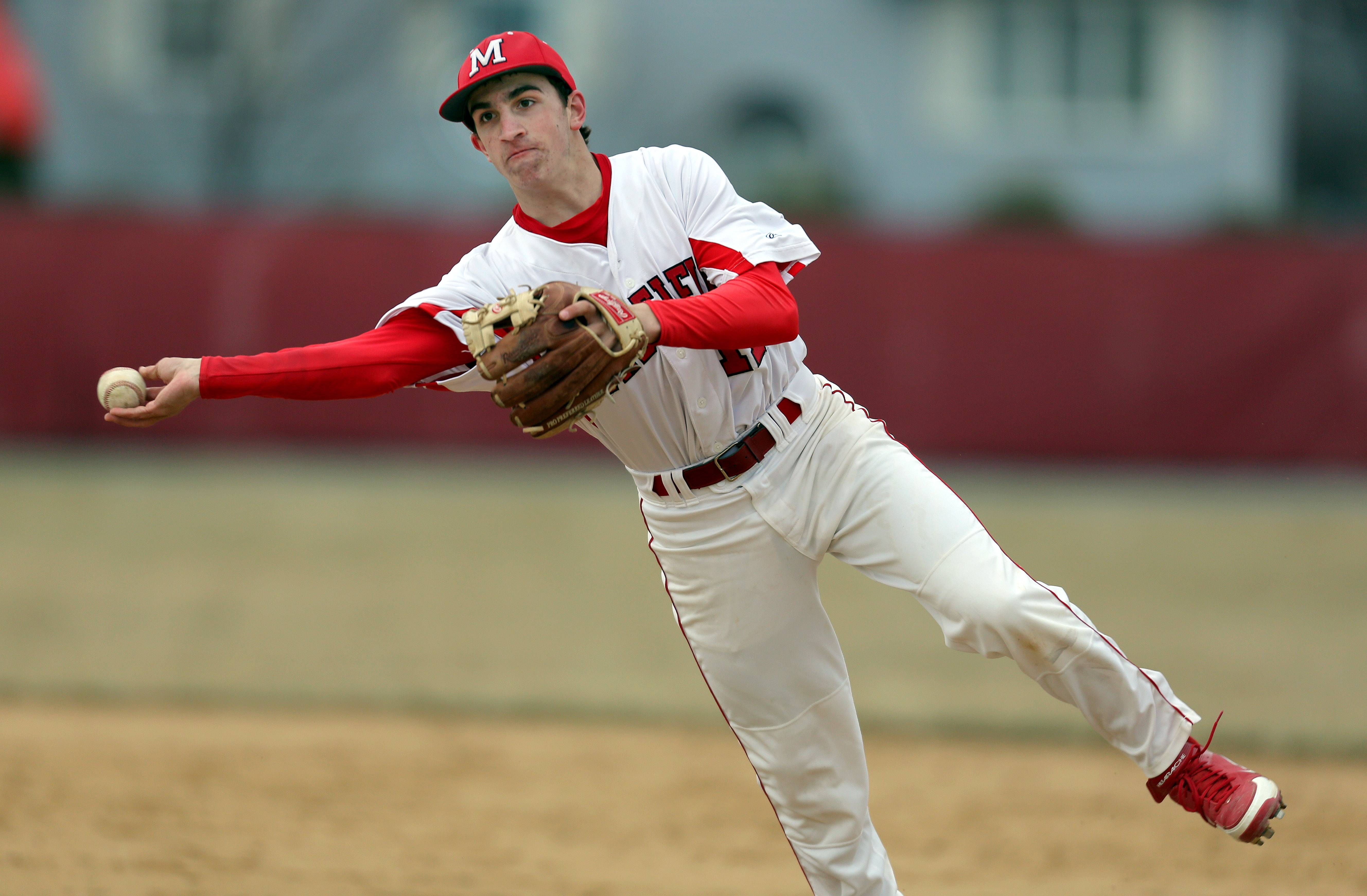 Mundelein's Wes Farmer throws to first against Wheeling on Wednesday at Mundelein.
