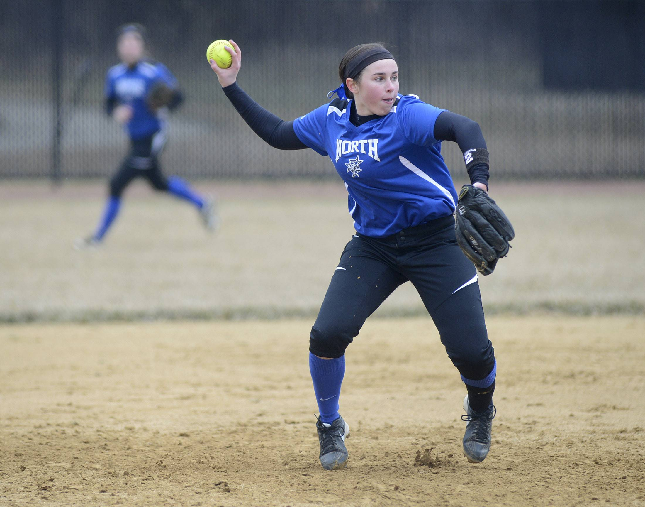 Laura Stoecker/lstoecker@dailyherald.comSt. Charles North's Erin Nemetz throws to first base in the fourth inning of the game vs. Schaumburg on Wednesday, April 2.