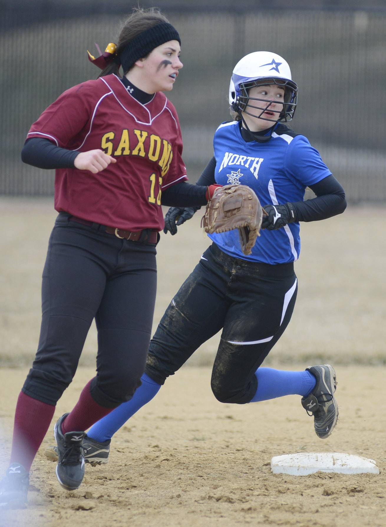 Laura Stoecker/lstoecker@dailyherald.comSchaumburg's Natalie Napier covers second base as St. Charles North's Alex Millett comes around the bag in the second inning on Wednesday, April 2.