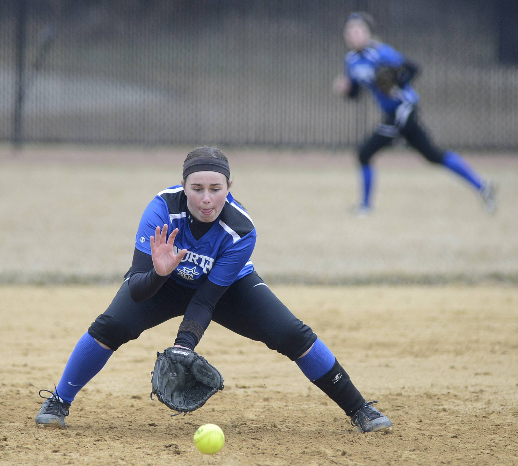 St. Charles North's Erin Nemetz fields a grounder against Schaumburg during the North Stars' 3-0 win Wednesday in St. Charles.
