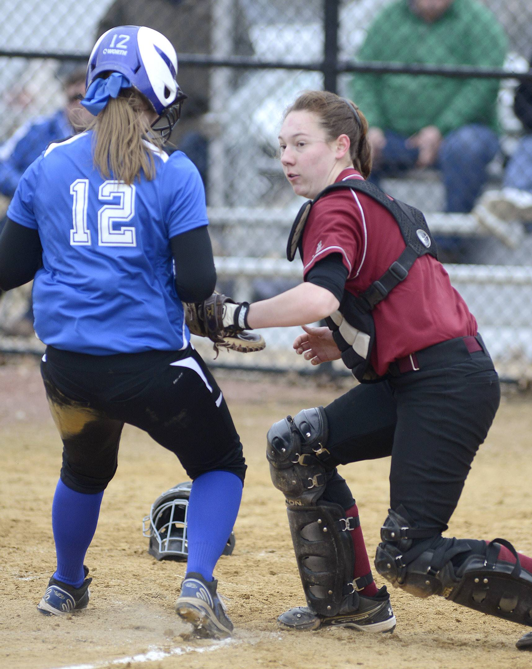 Laura Stoecker/lstoecker@dailyherald.comSt. Charles North's Abby Howlett, meets Schaumburg catcher Elaine Walker at home plate in the first inning on Wednesday, April 2.