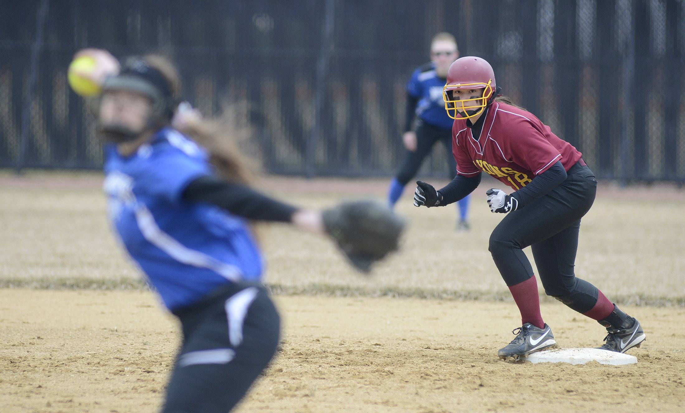 Laura Stoecker/lstoecker@dailyherald.comSchaumburg's Christina Candotti leans off second base as St. Charles North's Sabrina Rabin throws a pitch in the fourth inning on Wednesday, April 2.