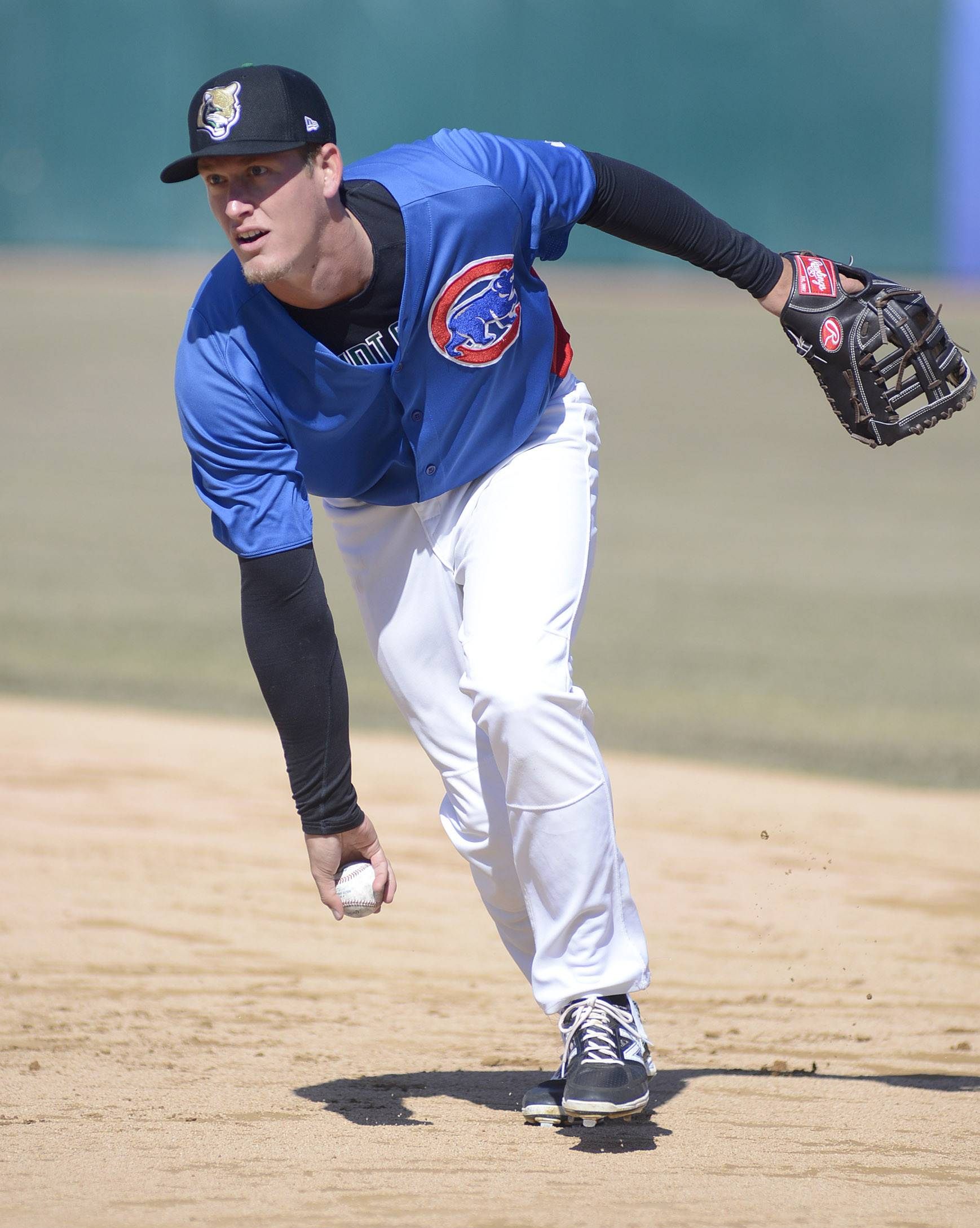 Kane County Cougars infielder Jacob Rogers takes some infield practice at Fifth Third Ballpark in Geneva on Tuesday.