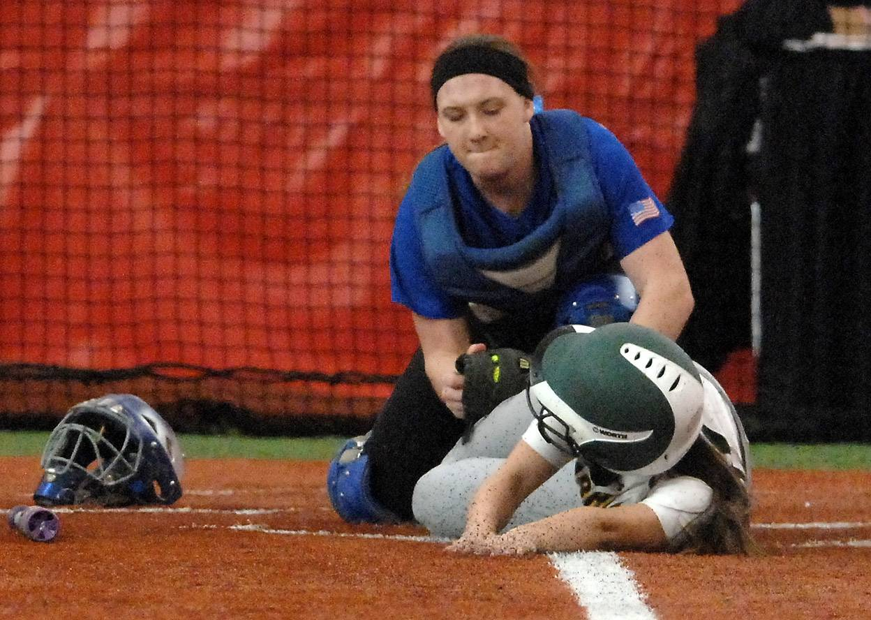 Burlington Central's Bekah Harnish tags out Waubonsie Valley's Sabrina Calabrese at the plate during softball action in Rosemont Wednesday.
