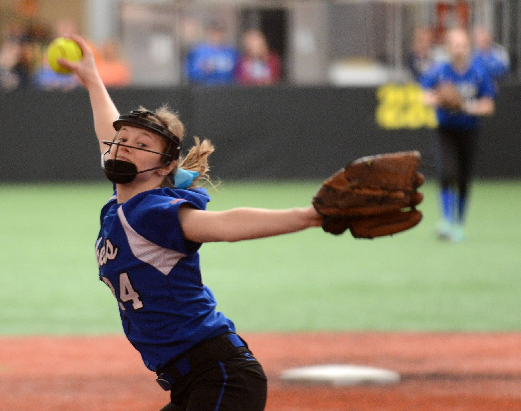 Burlington Central's Emily Kisch delivers a pitch against Waubonsie Valley during softball action in Rosemont Wednesday.