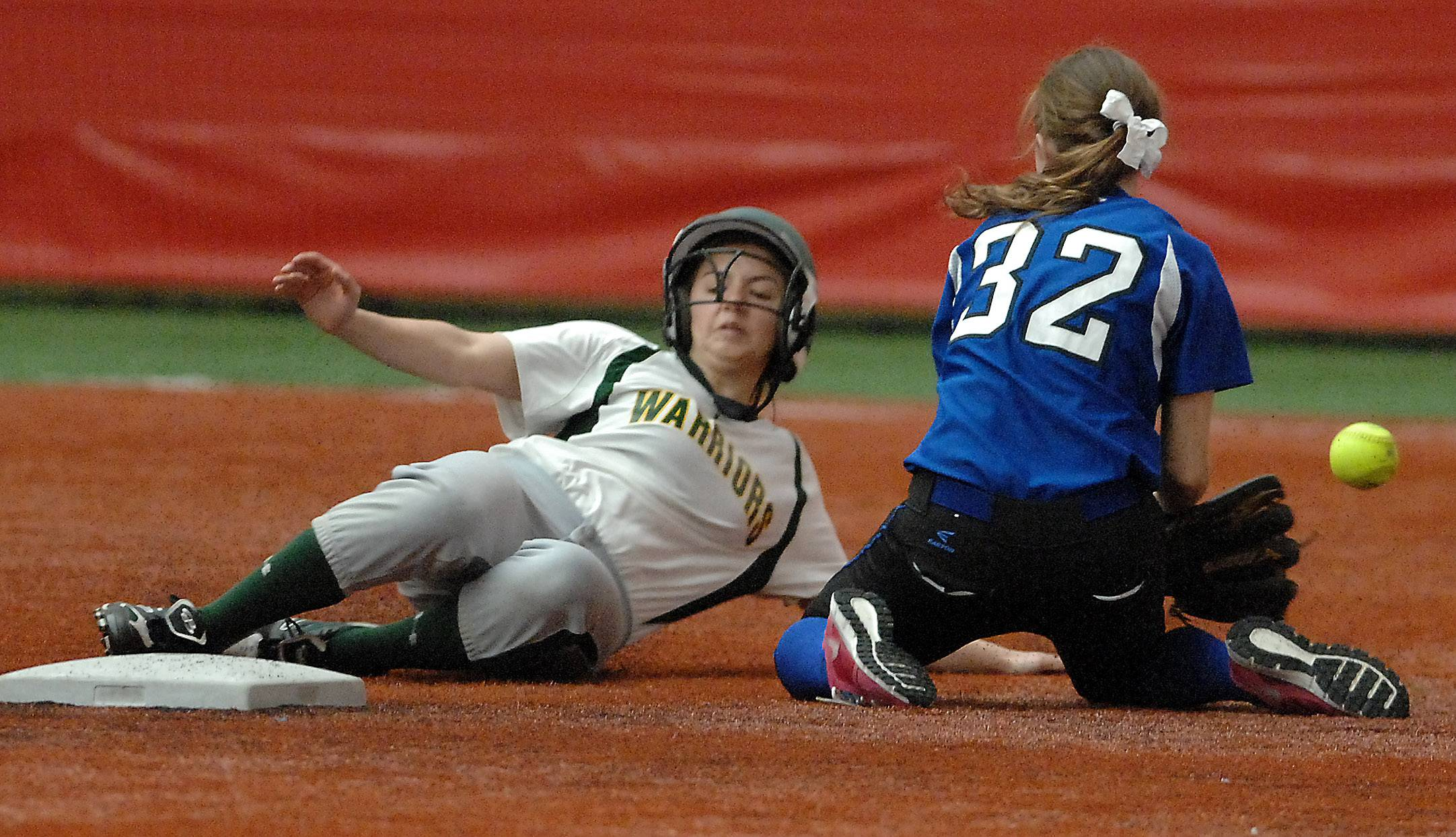 Waubonsie Valley's Sabrina Calabrese slides safely into second with a steal as Burlington Central's Tori Harvey takes the late throw during softball action in Rosemont Wednesday.