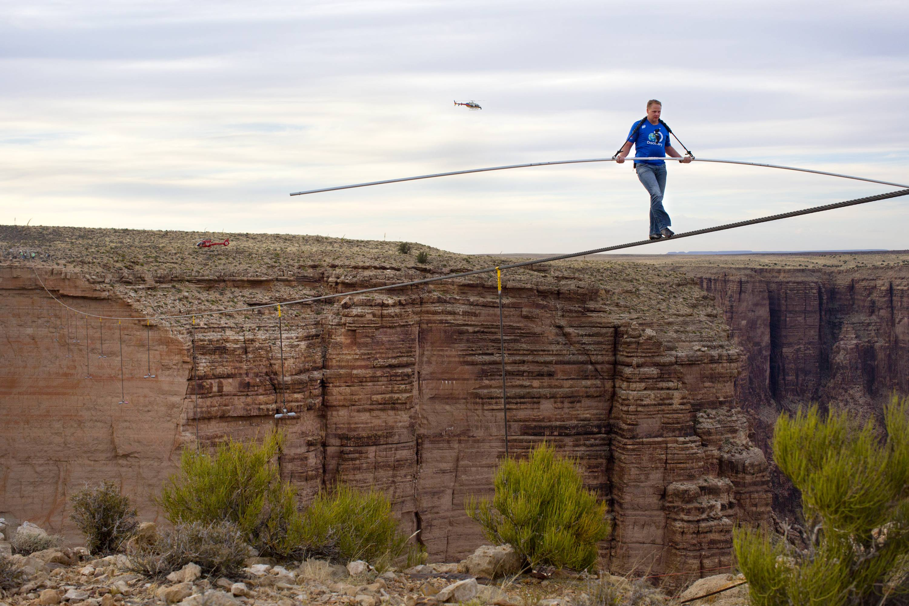 Nik Wallenda walks across the Little Colorado River Gorge on the Navajo Nation near Cameron, Ariz., for Discovery Channel last June 23. Wallenda is taking his tightrope to Chicago for a high-wire walk to be televised this fall.