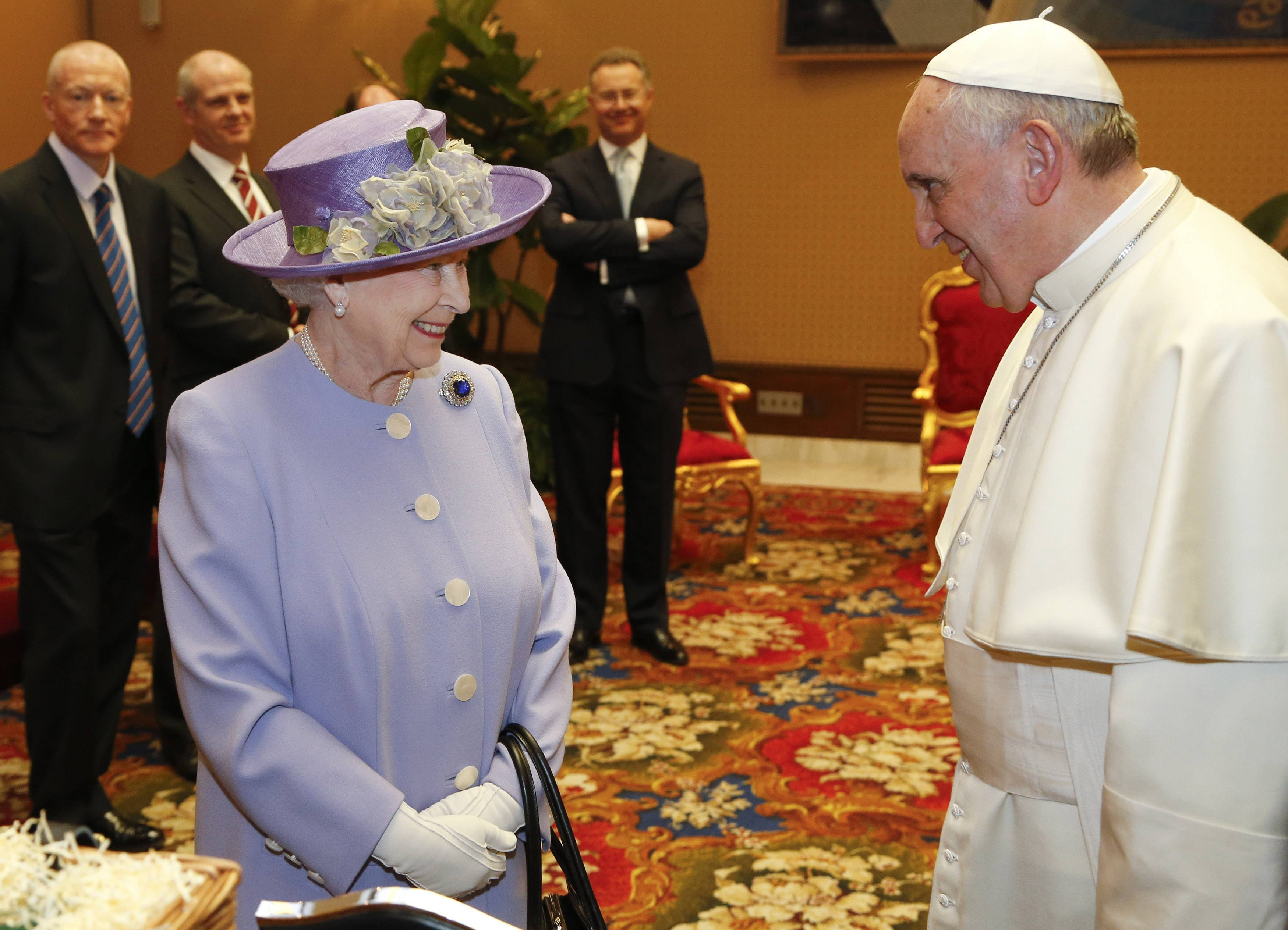Britain's Queen Elizabeth II smiles as she talks to Pope Francis during a meeting at the Vatican, Thursday, April 3, 2014. Queen Elizabeth II has come to Rome for lunch with Italy's president Giorgio Napolitano ahead of the British monarch's first meeting with Pope Francis.