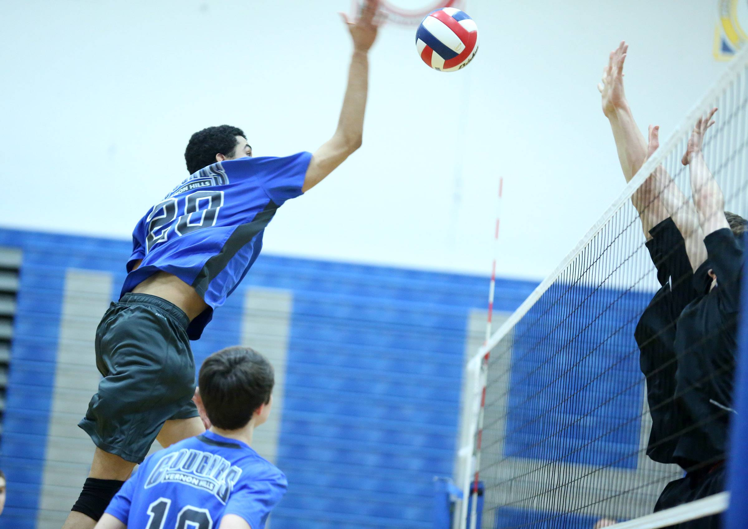 Vernon Hills' Lem Turner spikes the ball against Hersey on Friday at Vernon Hills.