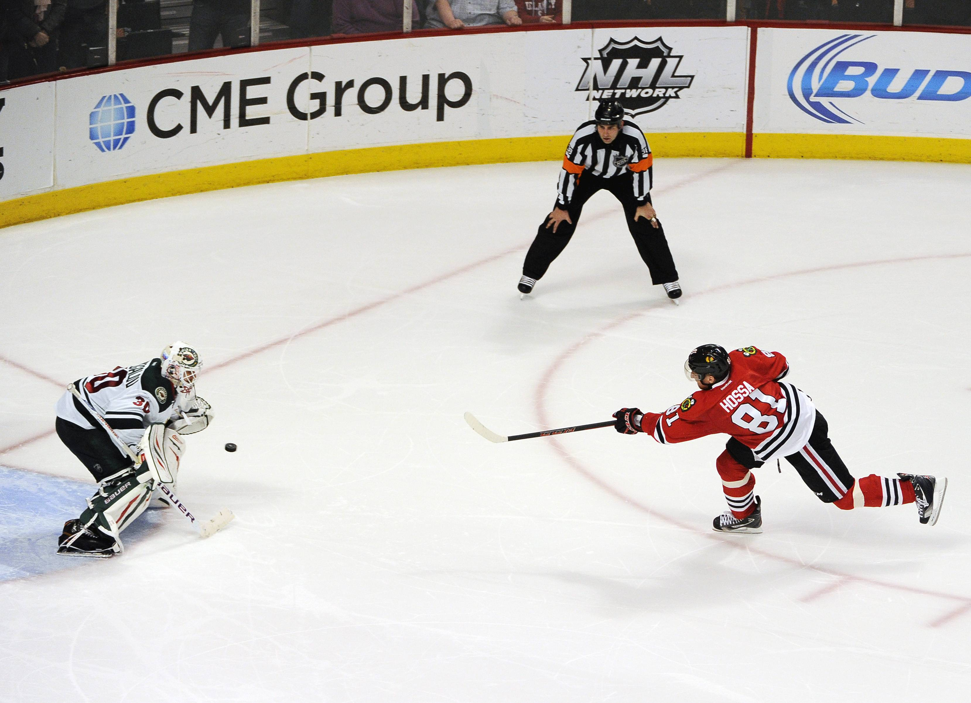 Blackhawks' Marian Hossa (81) scores the game winning goal on Minnesota Wild goalie Ilya Bryzgalov in a shootout during an NHL hockey game in Chicago, Thursday, April 3, 2014. The Blackhawks won 3-2. (AP Photo/David Banks)
