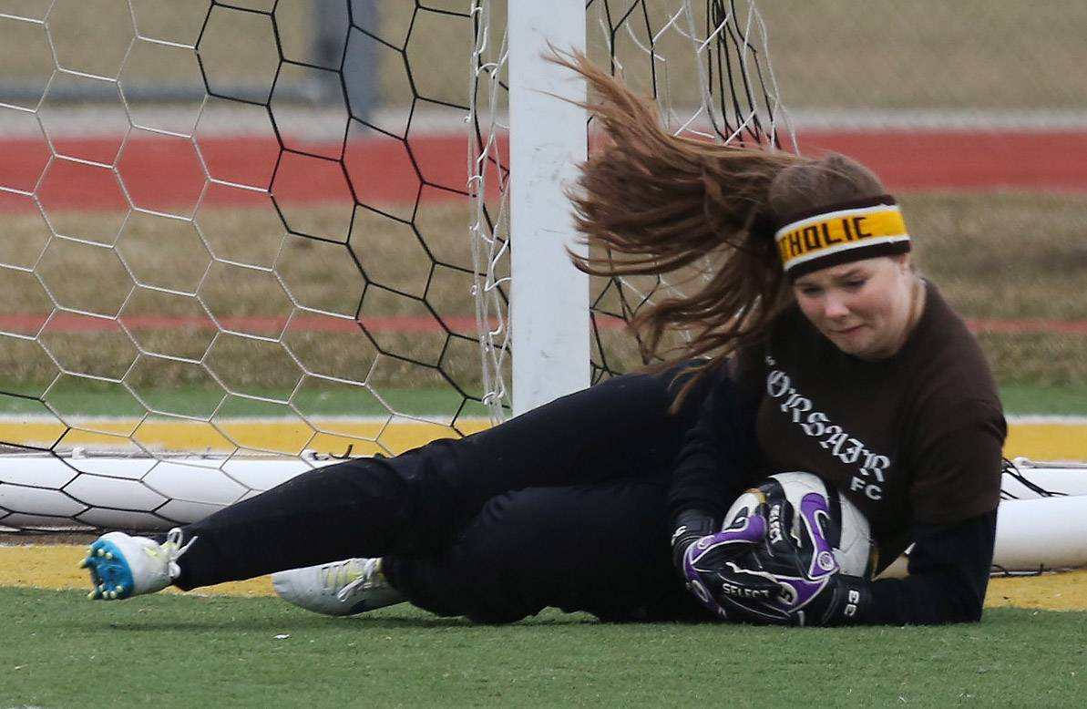Carmel Catholic goalie Mackenzie Burns stops a shot by visiting Lake Forest on Thursday.
