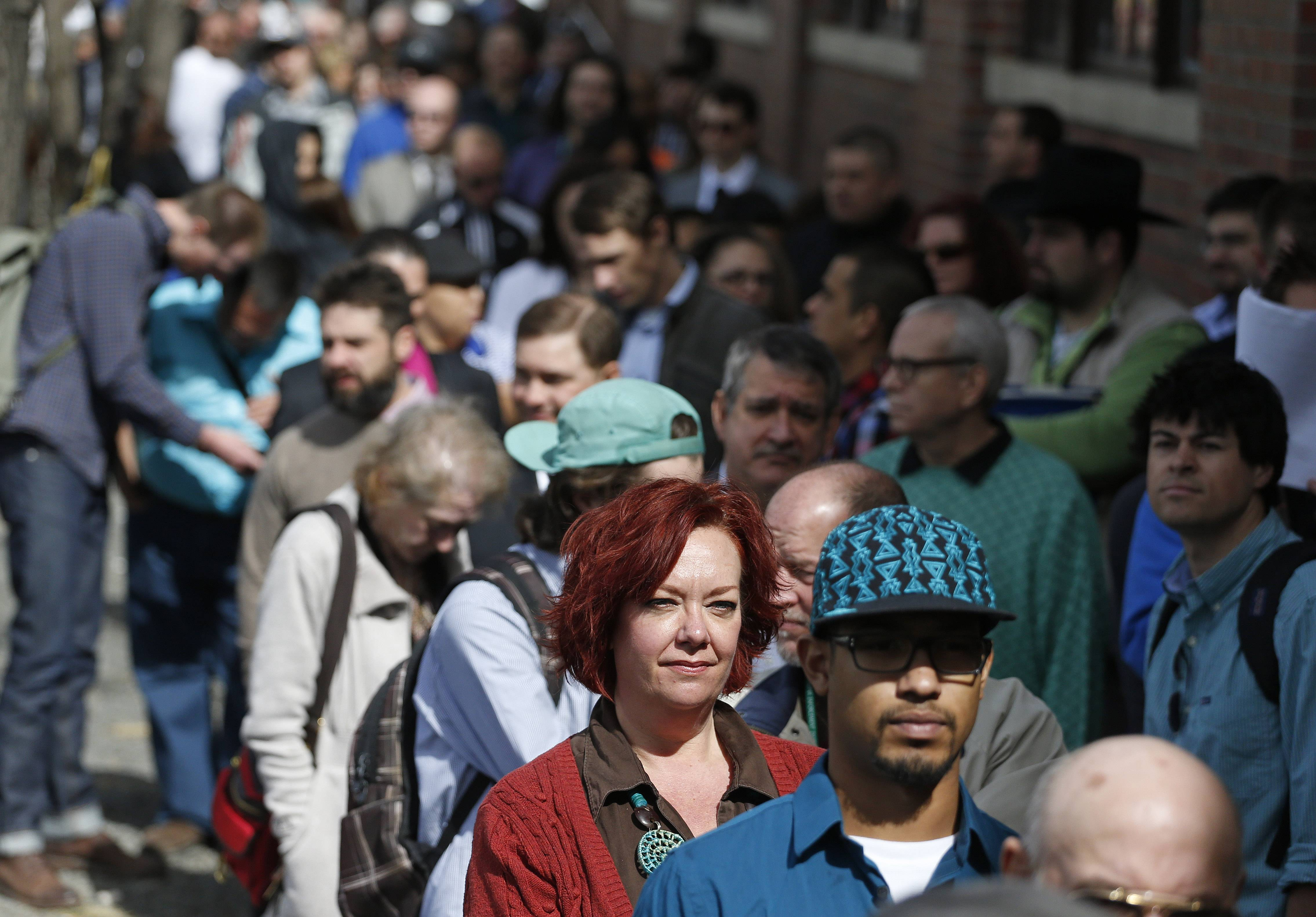 Job seekers line up in the hundreds to attend a marijuana industry job fair hosted by Open Vape, a vaporizer company, in Downtown Denver.