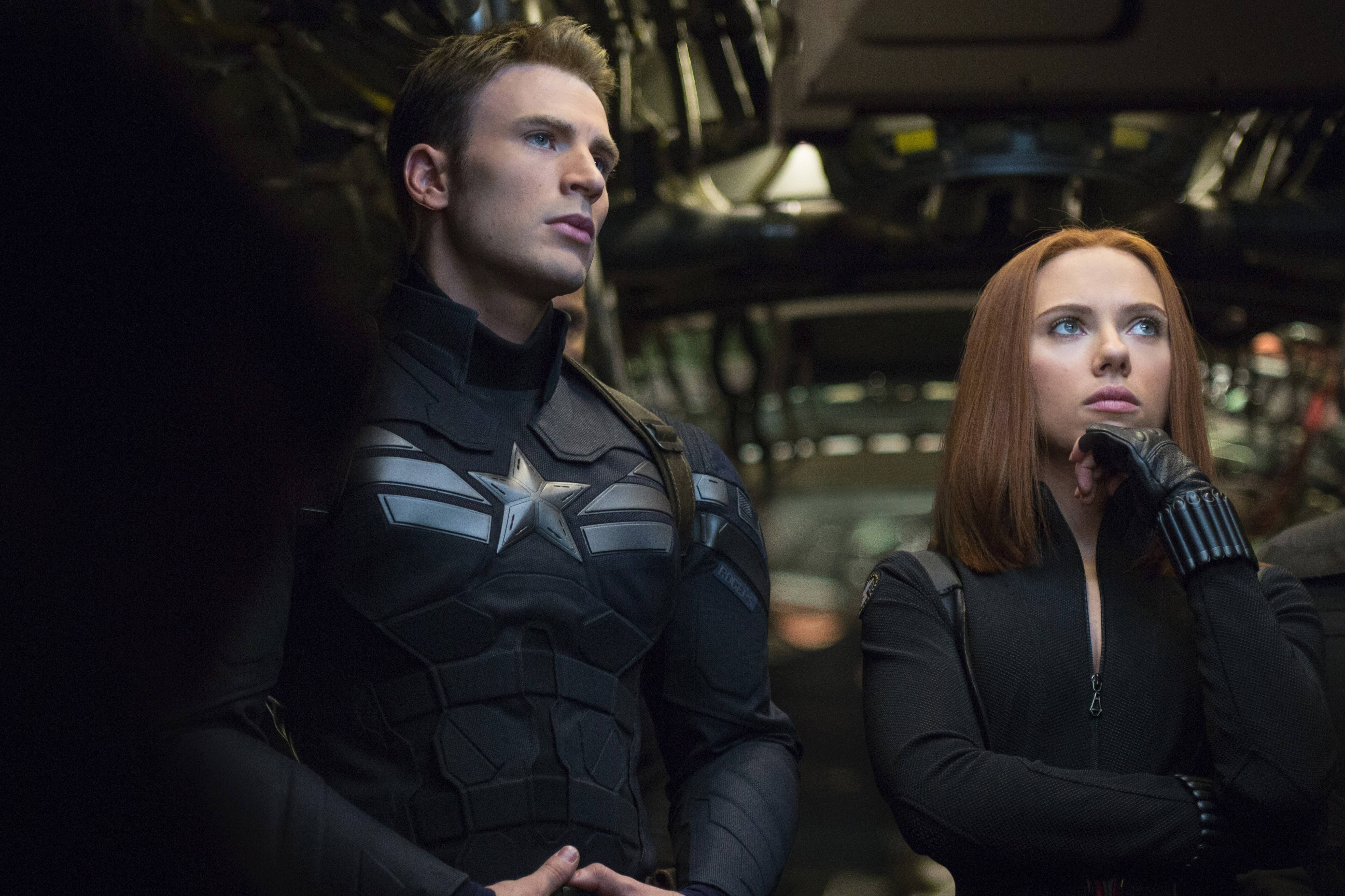 "Steve Rogers (Chris Evans) reluctantly teams up with Black Widow (Scarlett Johansson) to purge SHIELD of traitors in the superhero thriller ""Captain America: The Winter Soldier."""