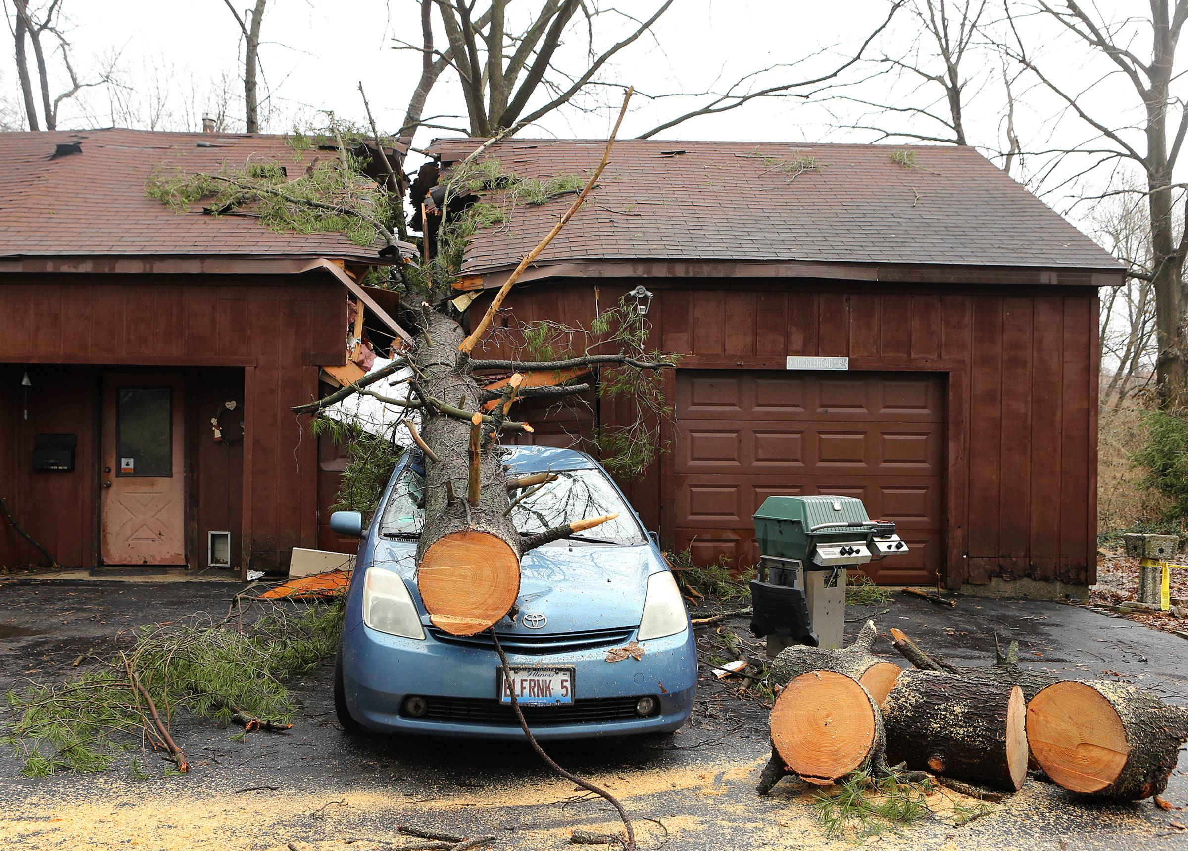 A strong storm sent a tree through this home and garage, landing on a car Thursday in Belleville, Ill, but the storm that swept across the St. Louis region caused no injuries or significant damage in the metropolitan area's Illinois suburbs.