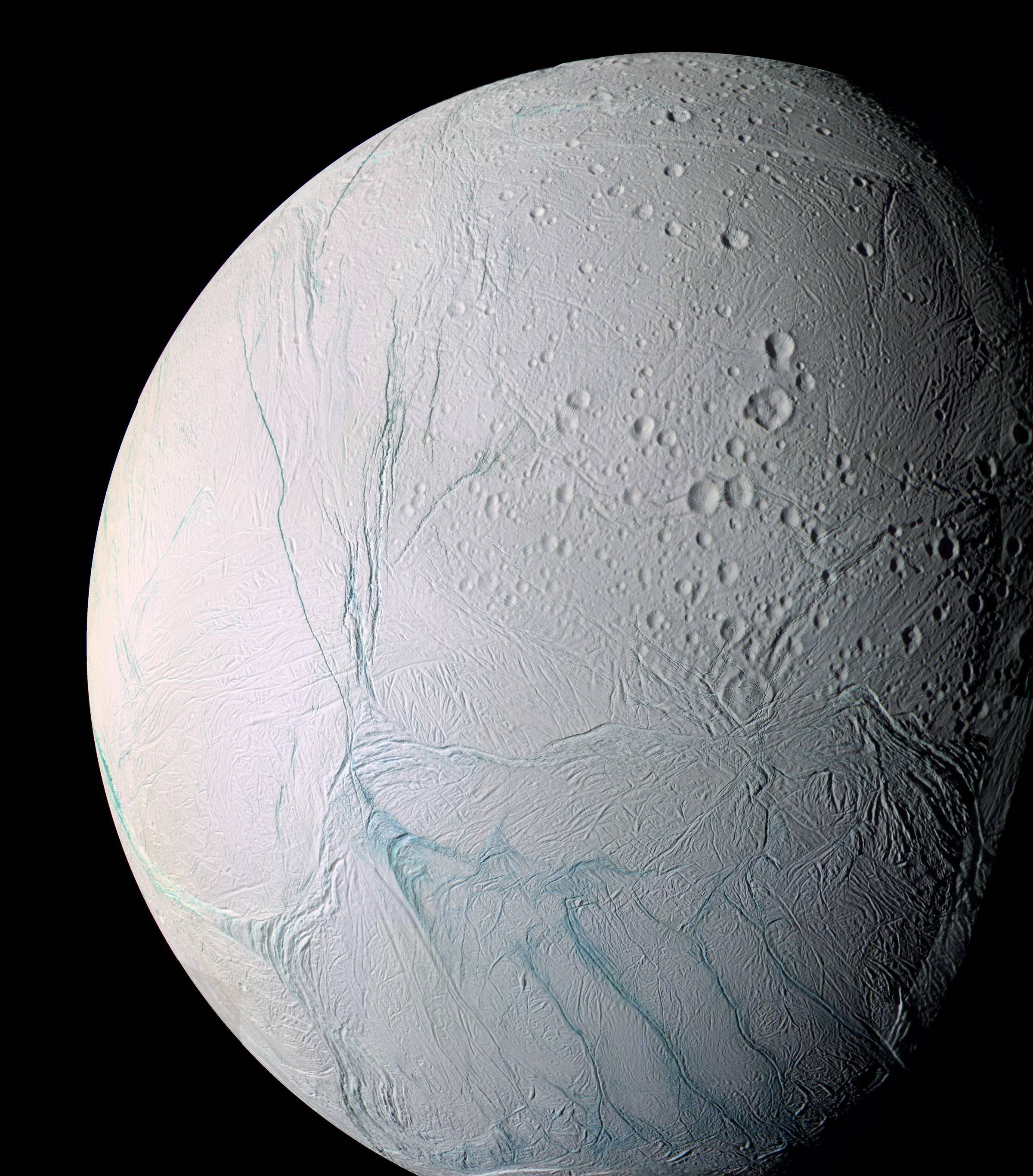 "This photo provided by NASA shows Saturn's moon Enceladus. The ""tiger stripes"" are long fractures from which water vapor jets are emitted. Scientists have uncovered a vast ocean beneath the icy surface of the moon, they announced Thursday."