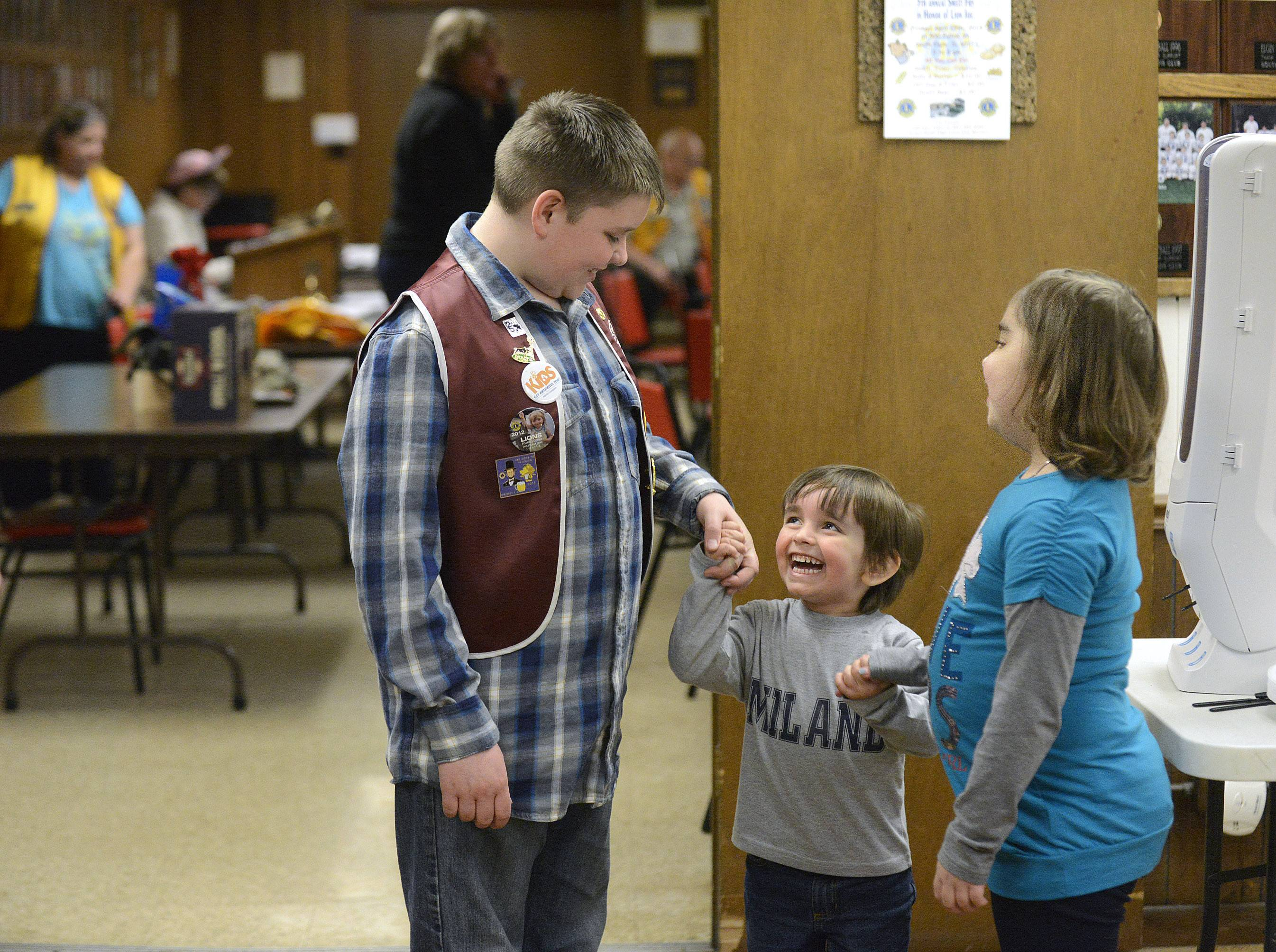 Dylan Snyder, 11, and Maria Serban, 6, they play with her younger brother, Victor, 3½, after Dylan presented Maria and her mother, Elena, with a check for close to $4,000 at the South Elgin Lions Club on Wednesday, April 2. Maria, a first-grader at Willard Elementary School, has a rare form of arthritis and was very sick the past few months. Dylan, a fifth-grader at the school, raised funds with a spaghetti dinner and auction last month at the Lions Club where his great grandfather, Leo Snyder, is a member.