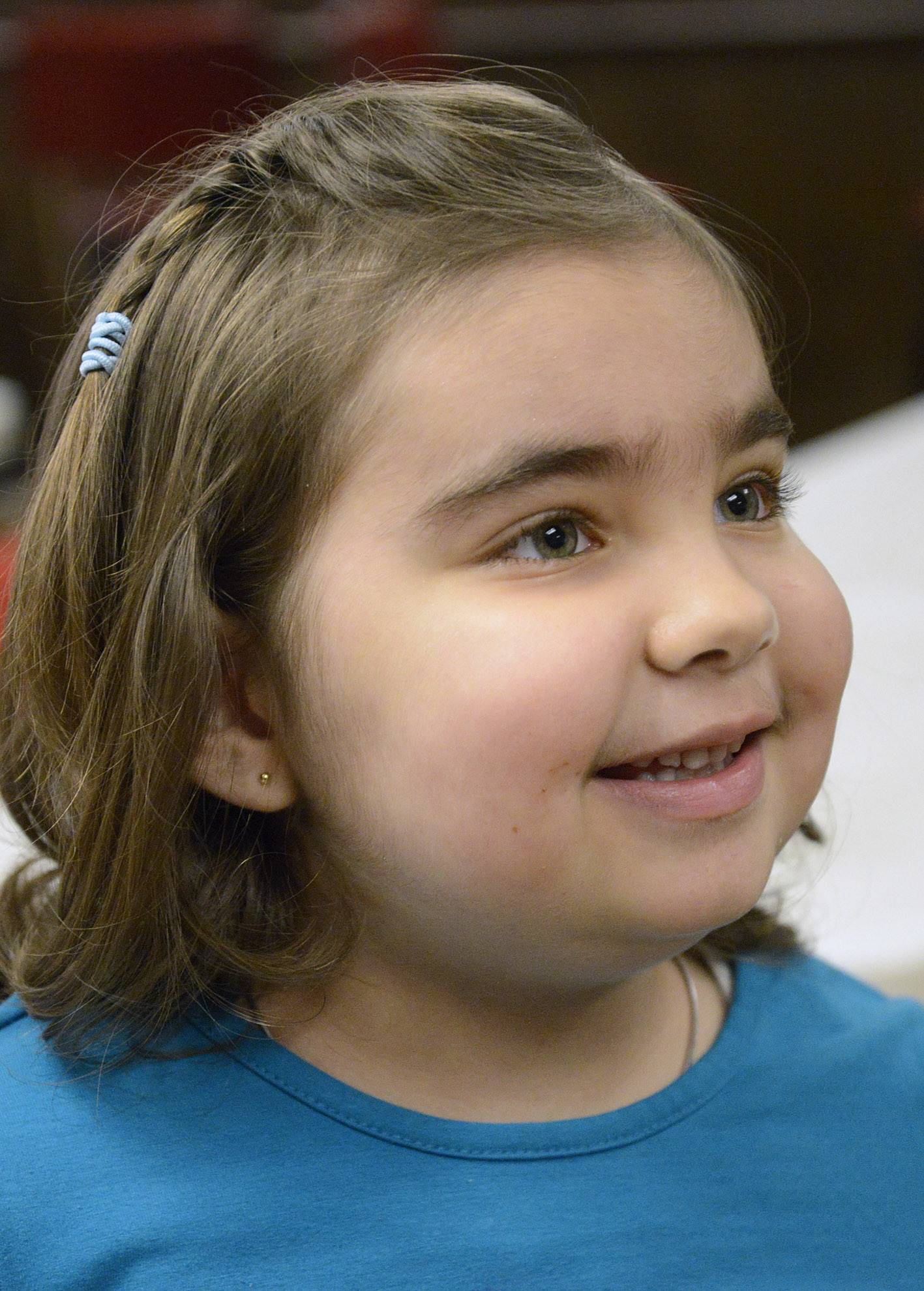 Maria Serban, 6, of South Elgin smiles as she talks to Dylan Snyder, 11, also of South Elgin, after Dylan presented Maria and her mother, Elena, with a check for nearly $4,000 at the South Elgin Lions Club on Wednesday, April 2. After the check presentation, they moved to another room allowing the Lions meeting to proceed as they got to know each other. Maria shared her experiences of being transported to the hospital in an ambulance and what happened to her at her hospital visits.